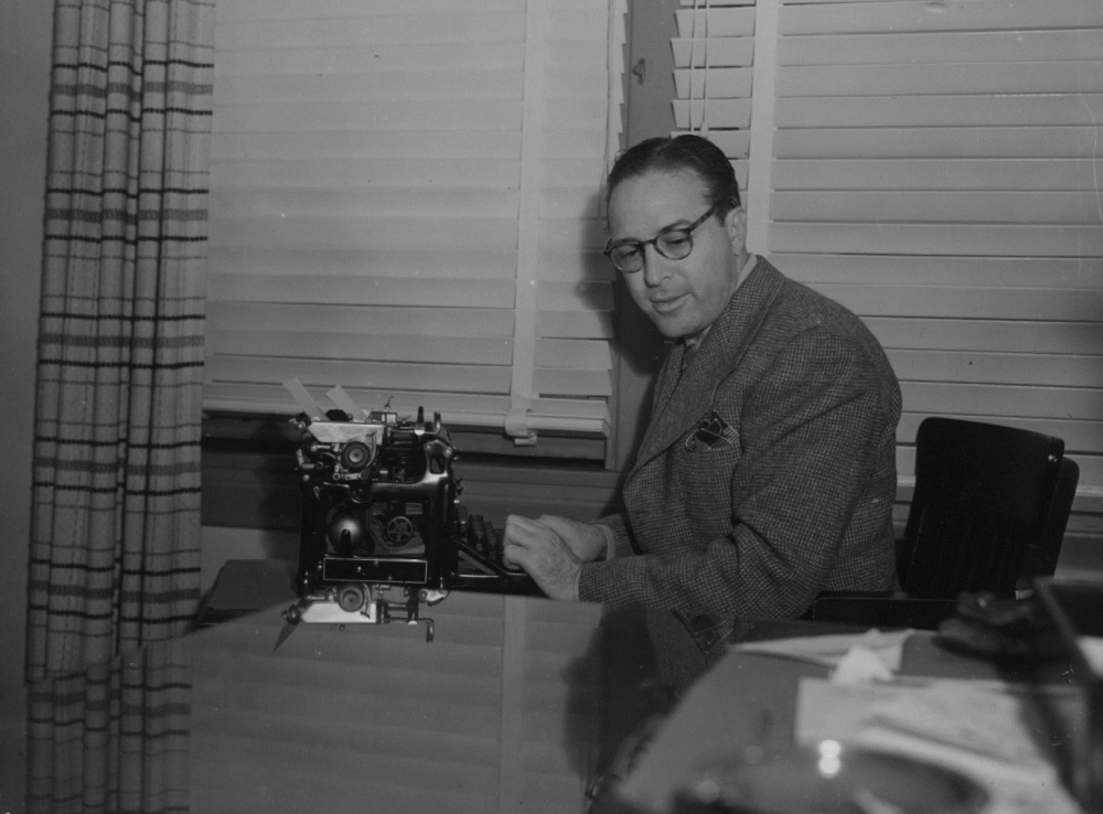 <p>Dalton Trumbo sits at his typewriter.</p>