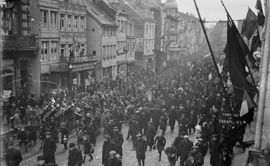 <p>An army band plays on a street in France on Armistice Day 1918.</p>