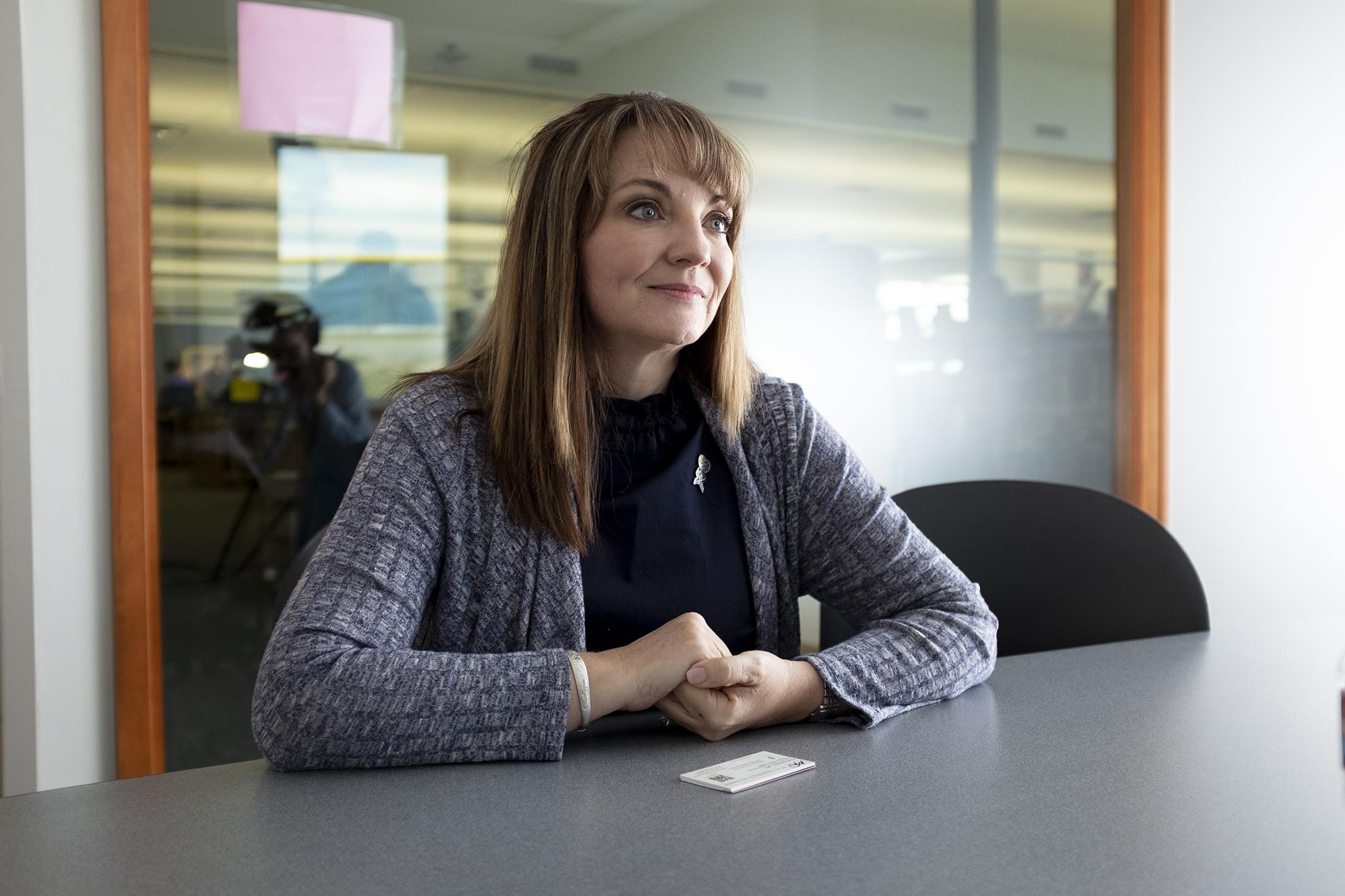 <p>Coni Sanders speaks to reporters inside Columbine High School, March 23, 2019.</p>
