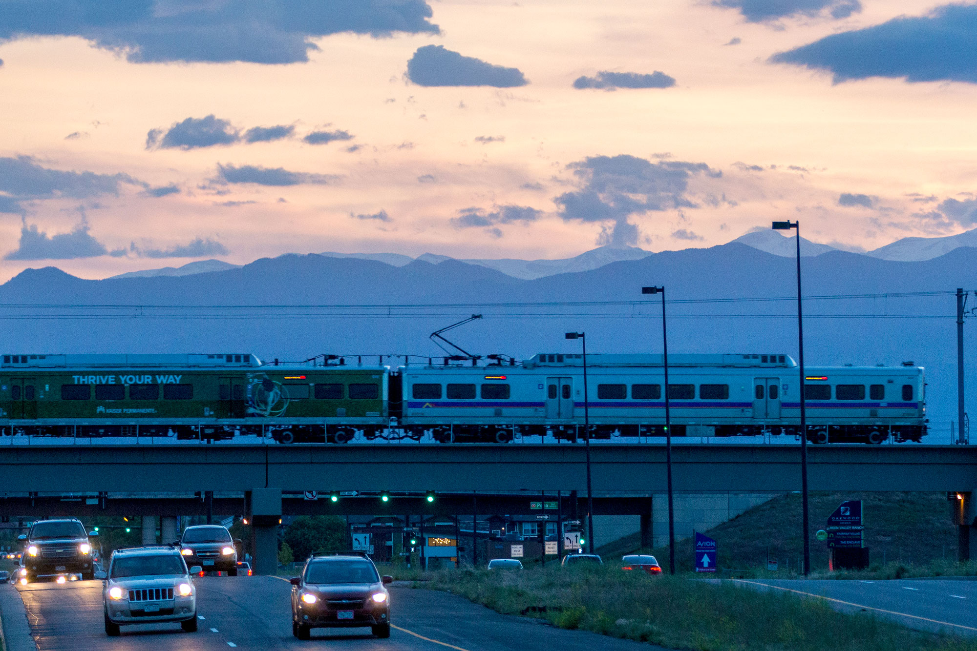 <p>An RTD A Line train crosses Green Valley Ranch Boulevard on its way to Denver International Airport June 12, 2019.</p>