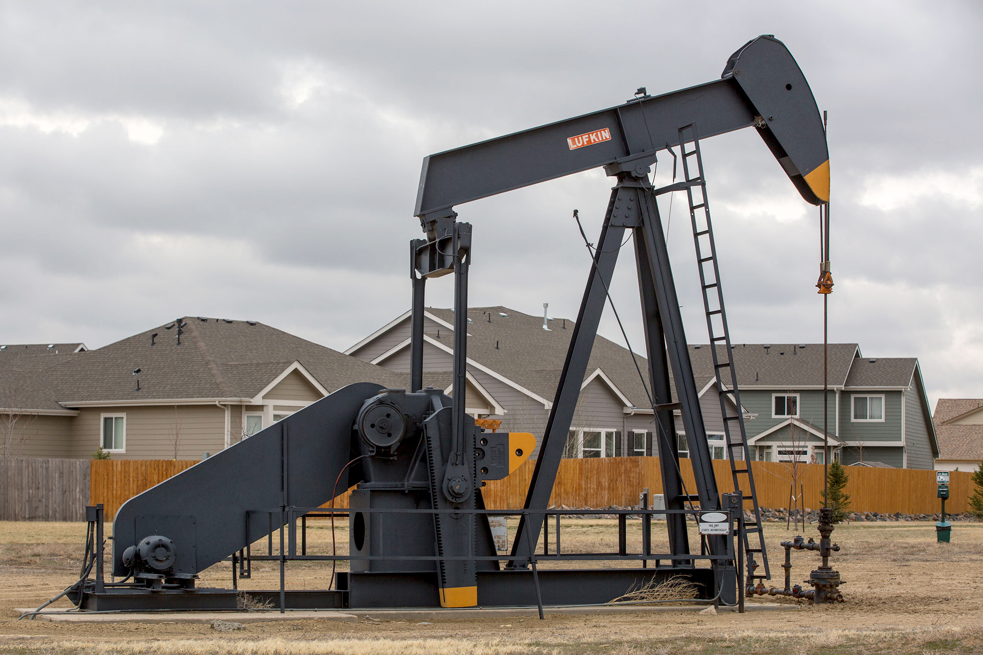 A pump jack in a traffic circle at 6th Street and Garfield Street, next to the Sharpe Farms housing development in Firestone on April 2, 2019.