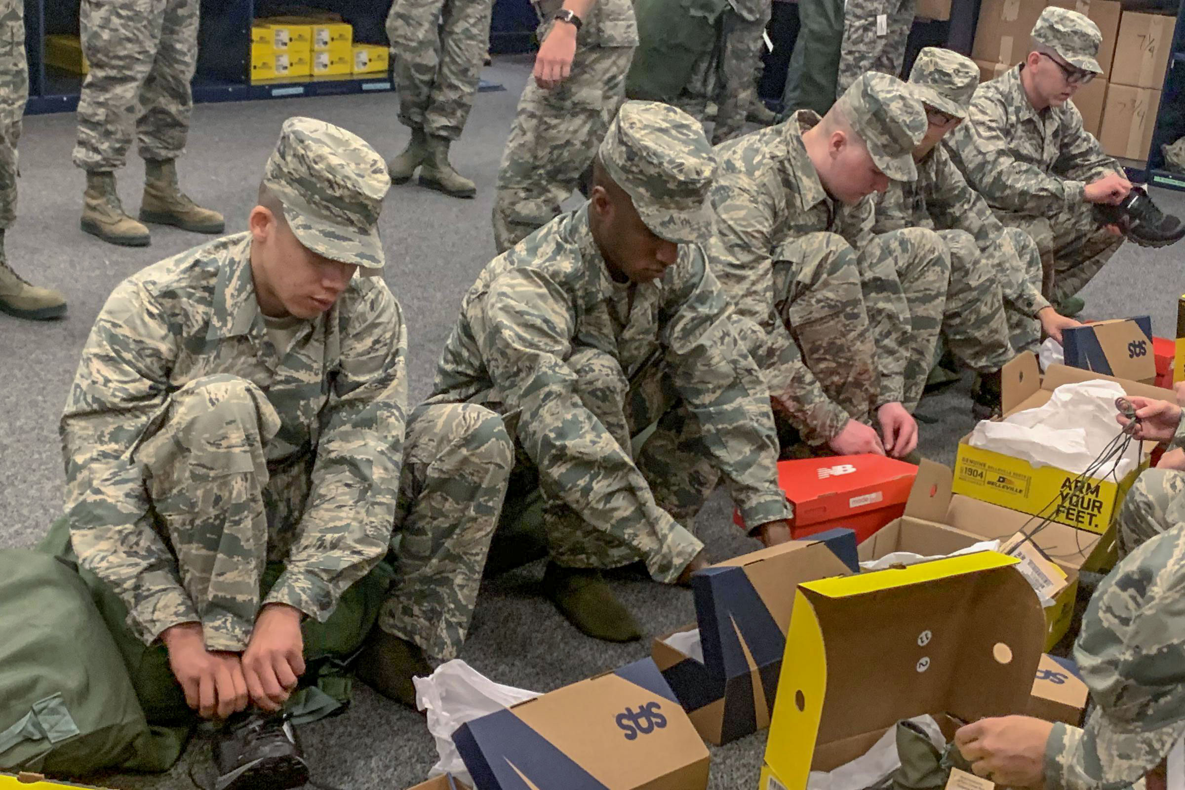 <p>New Air Force recruits try on shoes from San Antonio Shoemakers, Propper Footwear and New Balance. Since January, the Defense Department has been issuing the shoes free of charge to recruits.</p>