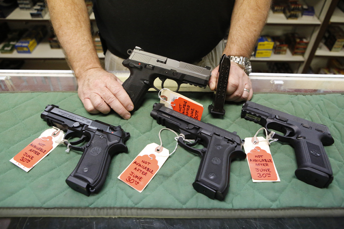The sale of guns like these was made illegal in Colorado in 2013because their magazines hold more than 15 rounds.