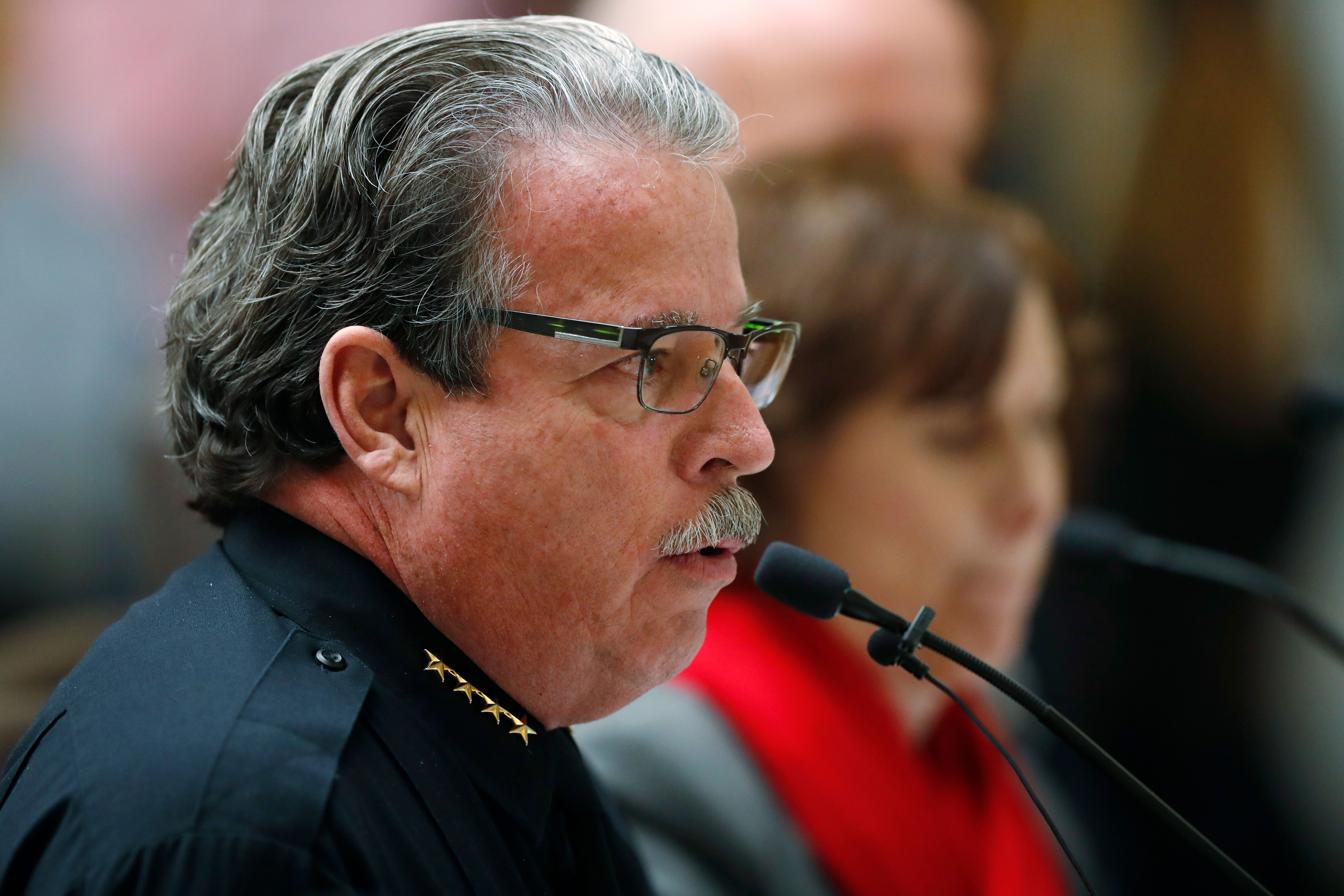 "<p>Douglas County Sheriff Tony Spurlock, front, speaks as Jane Dougherty, who lost her sister, Mary Sherlack, in the mass shooting in Newtown, Ct., looks on during a hearing before the House Judiciary Committee on a bill to get a ""red flag"" gun law on the books in Colorado Thursday, Feb. 21, 2019, in Denver, Colo.</p>"