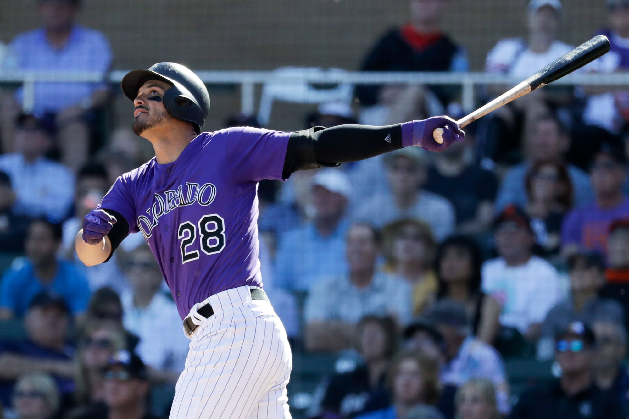 <p>Colorado Rockies' Nolan Arenado watches his two-run home run against the San Francisco Giants during the fifth inning of a spring baseball game in Scottsdale, Ariz., Sunday, March 3, 2019.</p>