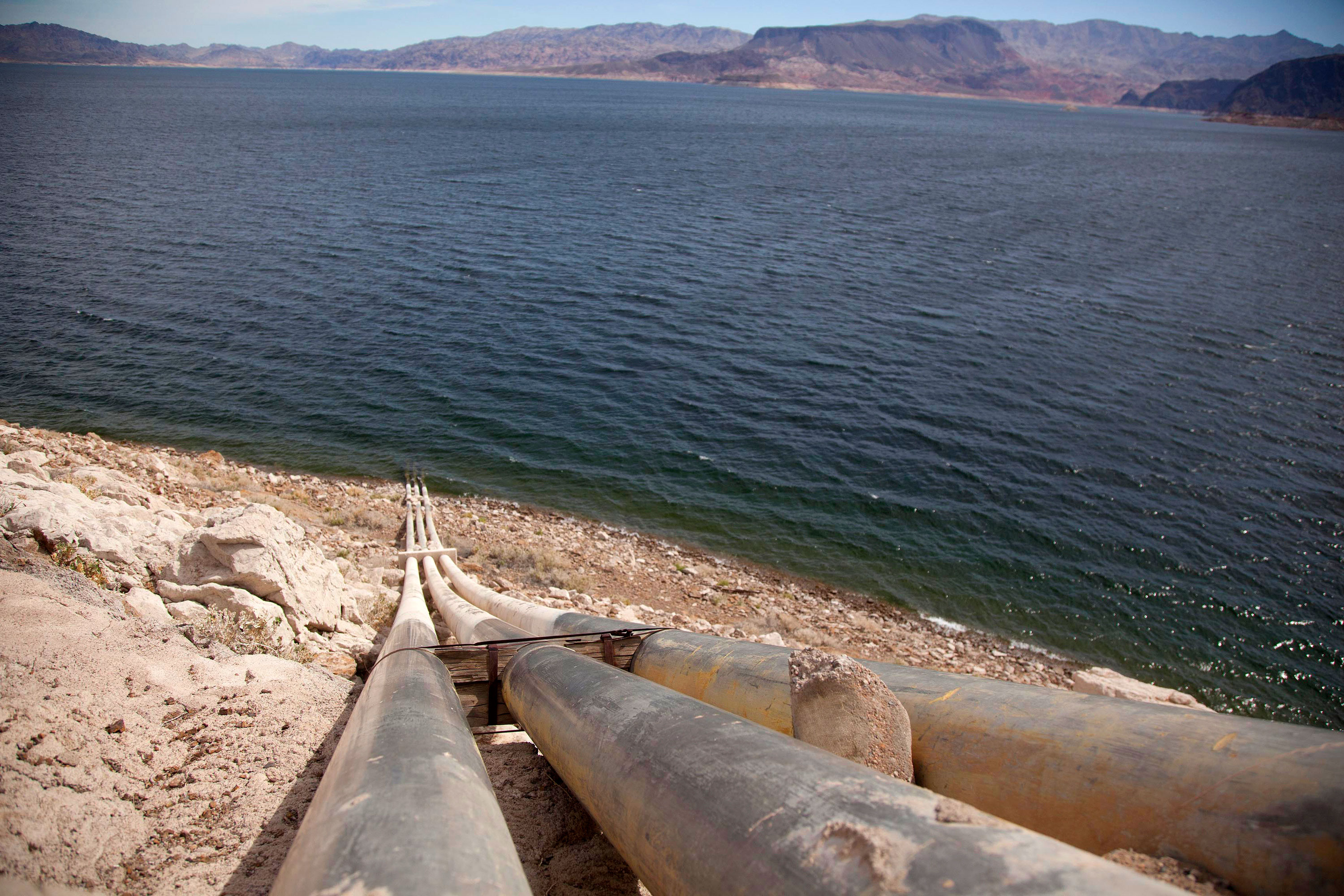 <p>Pipes extend into Lake Mead well above the high water mark near Boulder City, Nevada, March 23, 2012.</p>