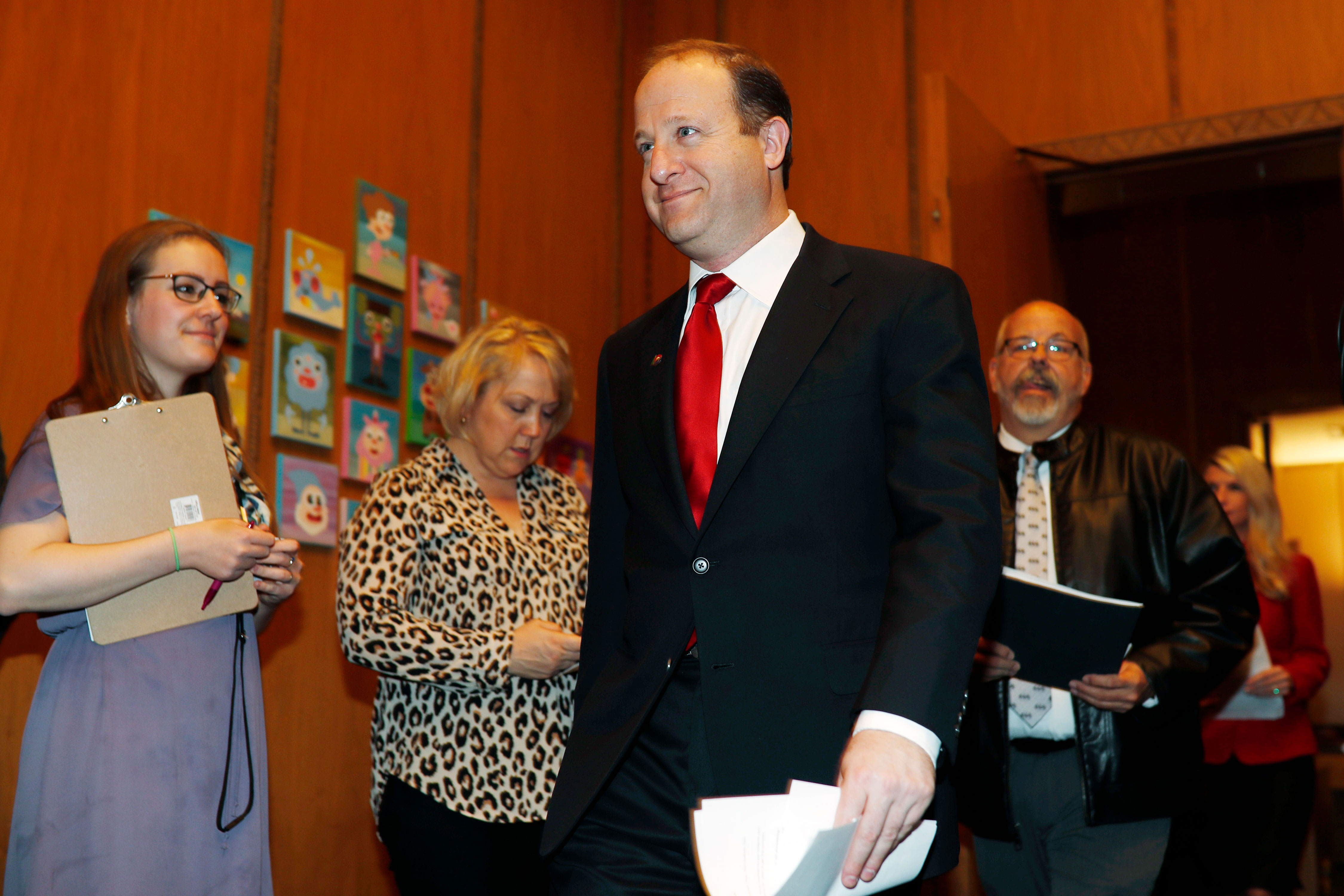 "<p>Colorado Gov. Jared Polis walks in to sign a bill to allow Colorado to become the 15th state in the union to adopt a ""red flag"" gun law, April 12, 2019, in the State Capitol in Denver.</p>"