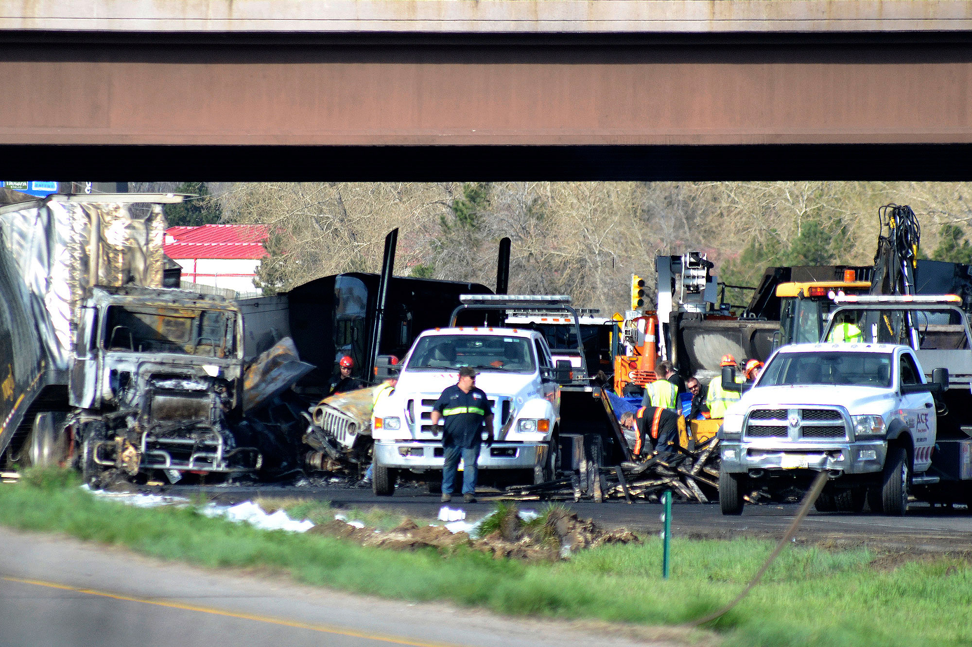<p>Authorities survey the scene of a fiery crash on I-70 near Colorado Mills Parkway that shut down the highway in both directions on Friday, April 26, 2019. Lakewood, Colo. A truck driver blamed for causing a deadly pileup involving over two dozen vehicles near Denver has been arrested on vehicular homicide charges. Lakewood police spokesman Ty Countryman said Friday that there's no indication that drugs or alcohol played a role in Thursday's crash.</p>