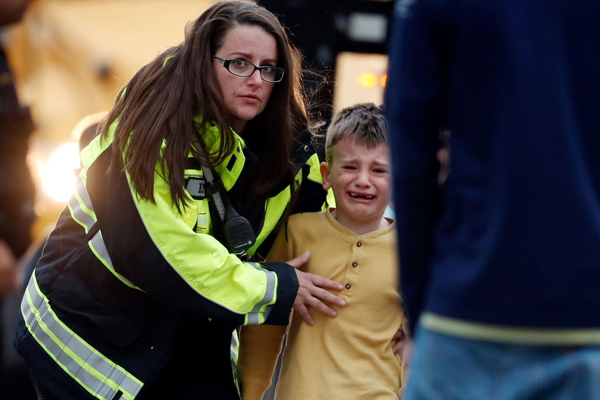 <p>Officials guide students off a bus and into a recreation center where they were reunited with their parents after a shooting at a suburban Denver middle school Tuesday, May 7, 2019, in Highlands Ranch, Colo.</p>