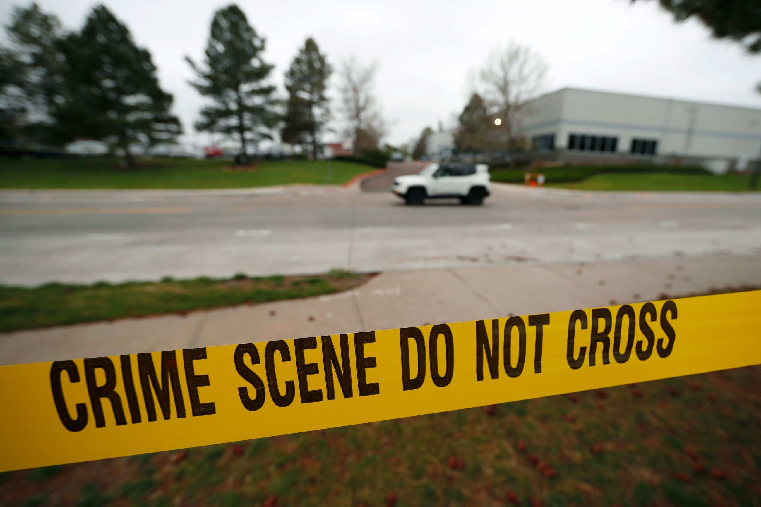 Police tape remains near the scene following Tuesday's shooting at STEM Highlands Ranch school, Wednesday, May 8, 2019, in Highlands Ranch, Colo.