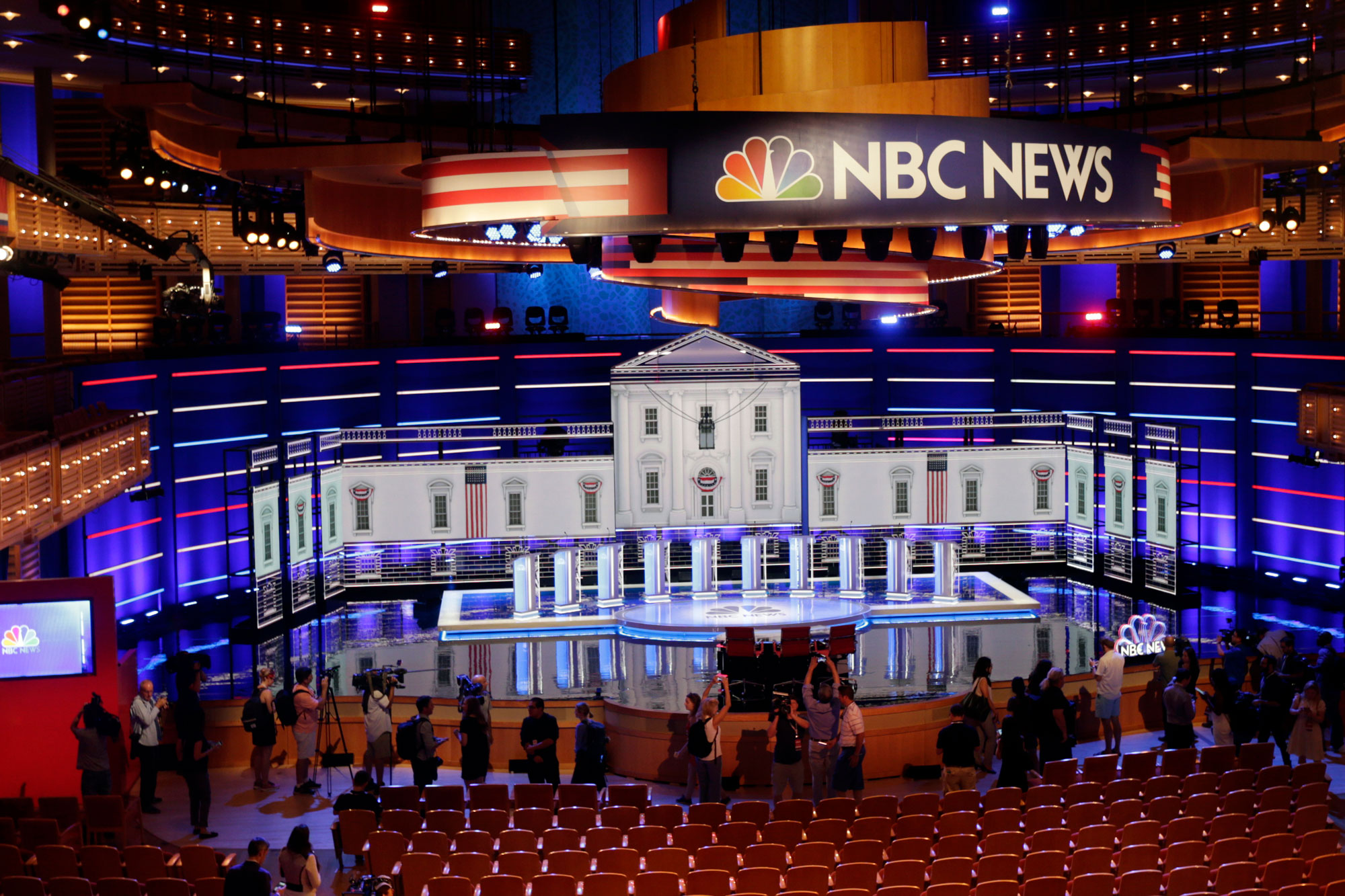 <p>Members of the media gather for a walk-through of the stage set-up for the first democratic debate, Wednesday, June 26, 2019.</p>