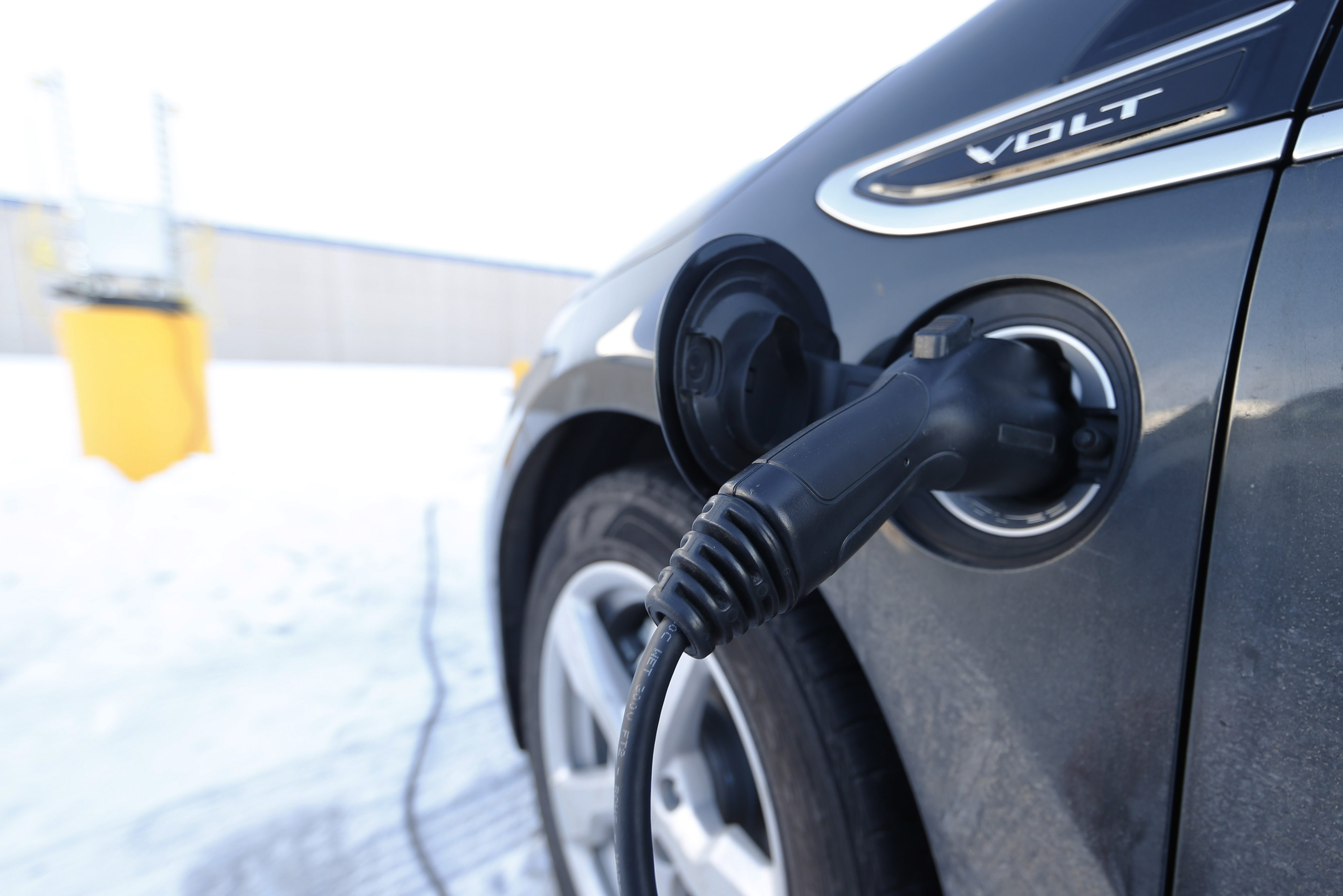 Chevrolet Volt charges at station
