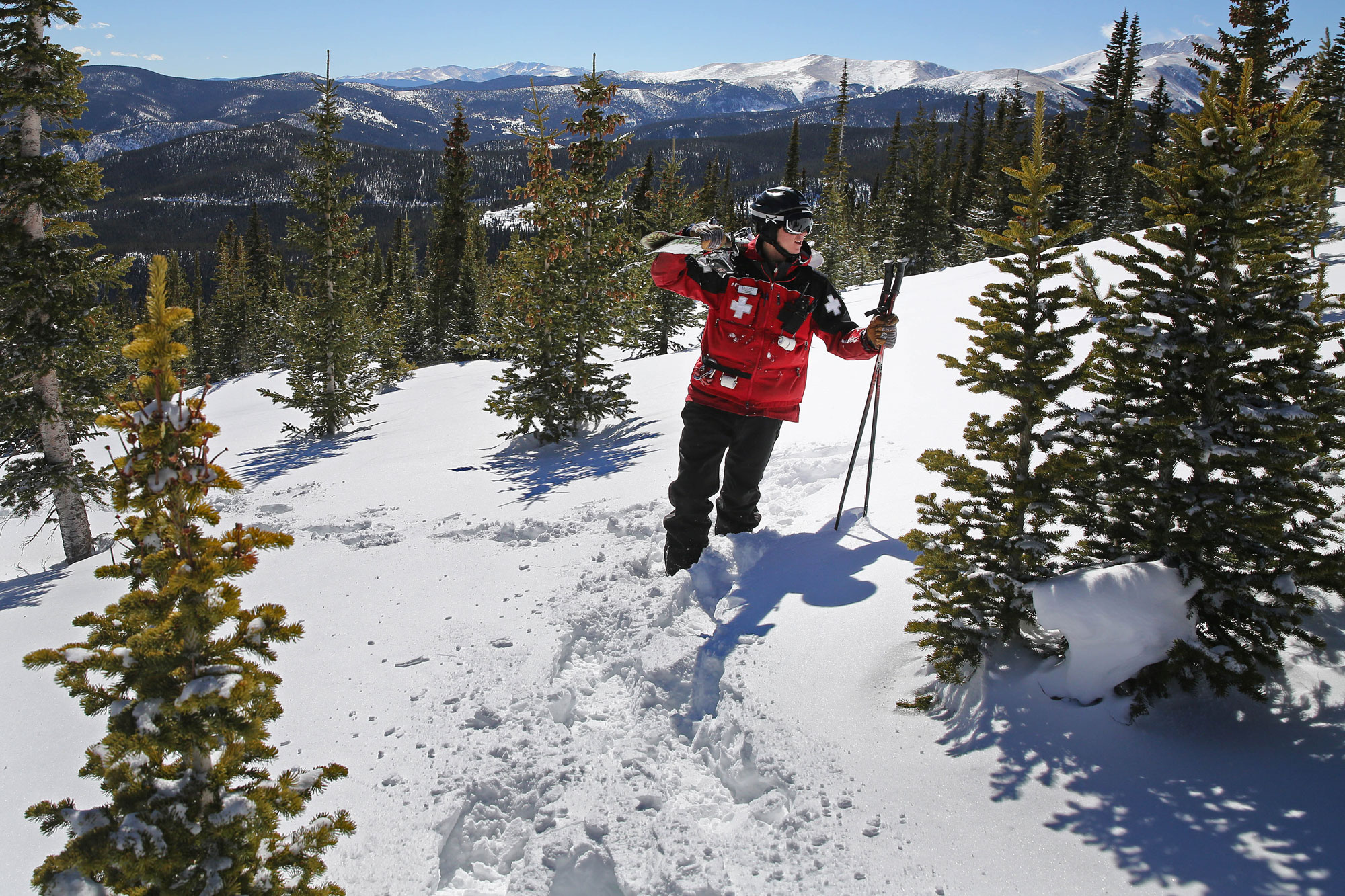 Eldora ski patroller Adam Clifton checks the density of the snow pack in a backcountry area of National Forest land adjacent to Corona Bowl, known for its extreme skiing, at Eldora Mountain Resort, near Nederland, Colo., Wednesday, Feb. 26, 2014.