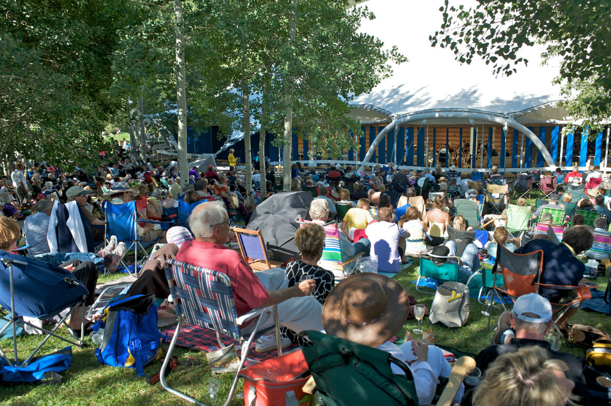 Festival attendees sit in lawn chairs outside Aspen Music Festival's Benedict Music Tent