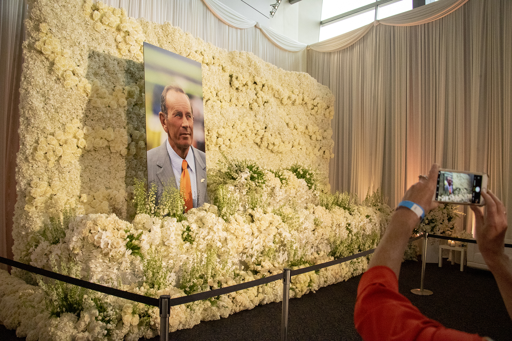 <p>Flowers surround a portrait of Pat Bowlen at Mile High Stadium, June 18, 2019. </p>
