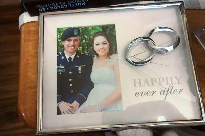 <p>Christopher and Andrea Cacho's wedding picture was among the many possessions damaged when the Army moved them from Kentucky to Virginia.</p>