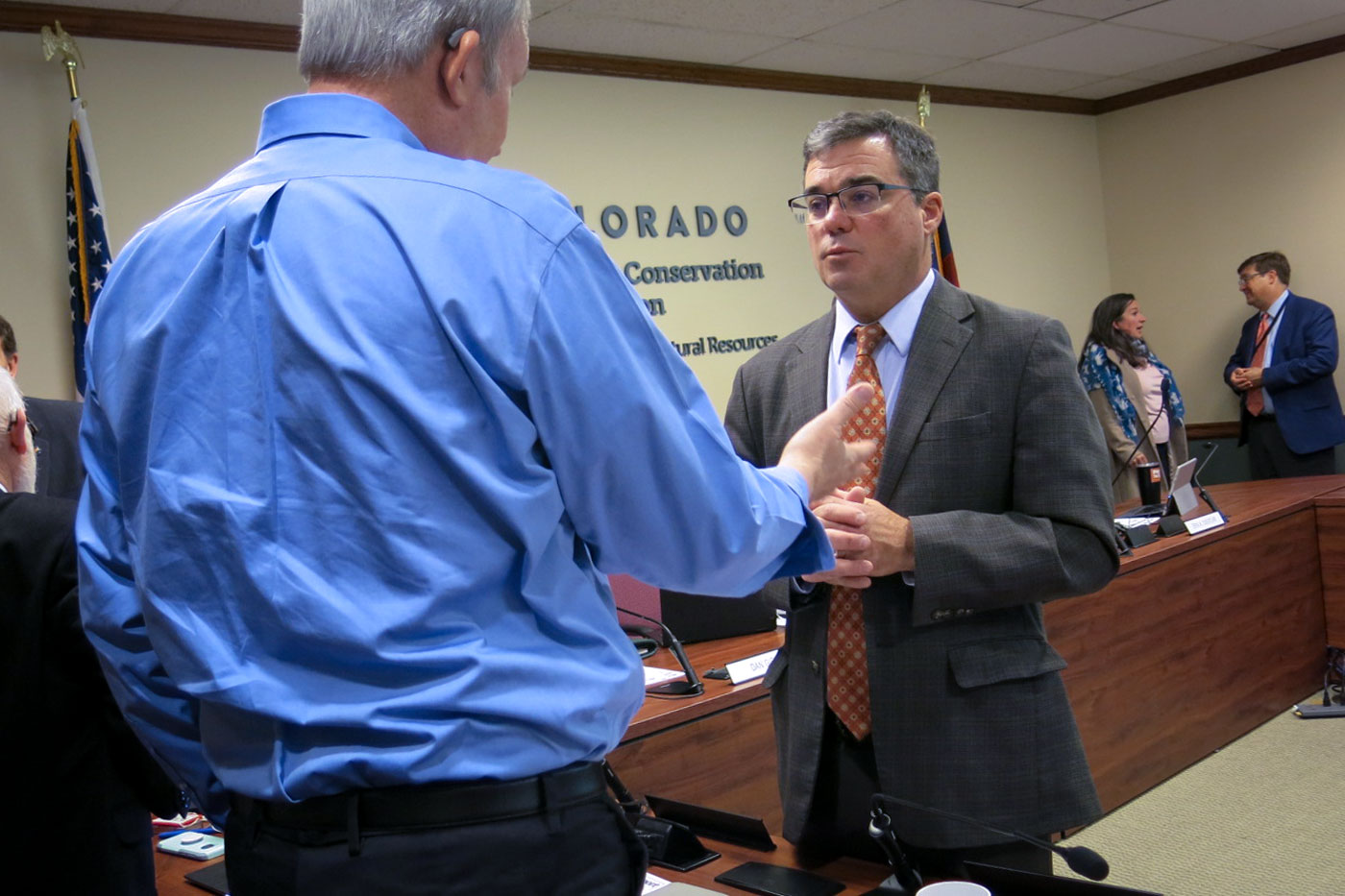 <p>Colorado Oil and Gas Conservation Commissiondirector Jeff Robbins meets with newly appointed commissioner Mark Hopkins, May 21, 2019.</p>