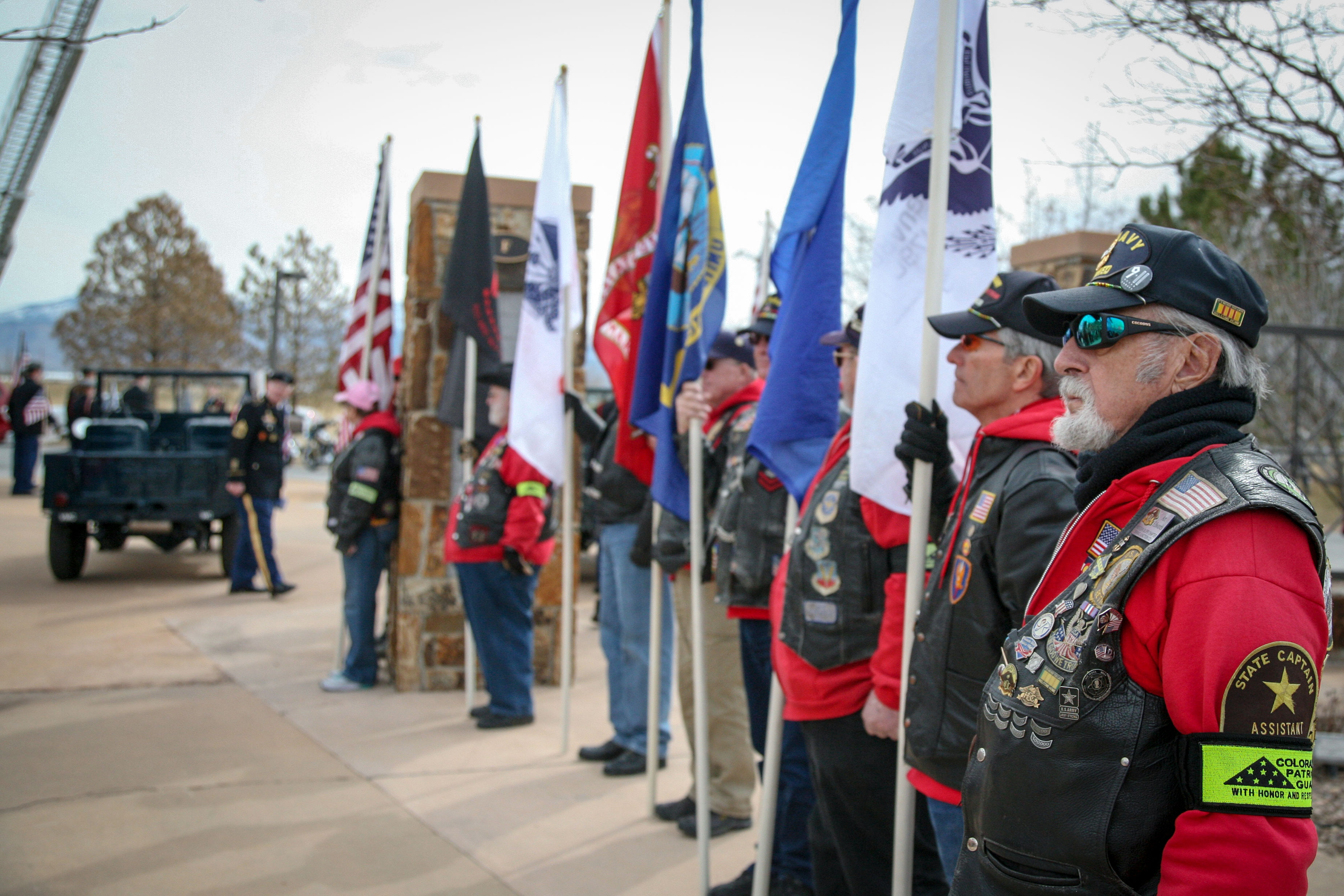<p>Members of the Western Slope Patriot Guard Riders stand guard over the ceremony at Veterans Memorial Cemetery of Western Colorado in Grand Junction.</p>