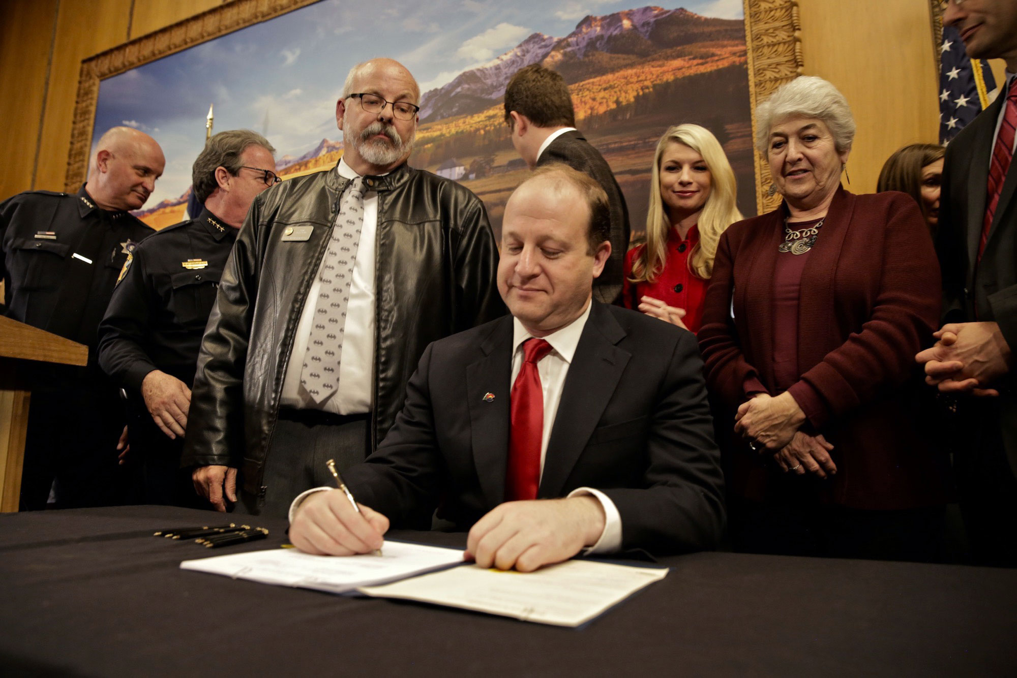 "<p>As state Rep. Tom Sullivan looks on, Colorado Gov. Jared Polis signs into law HB 1177 Friday, April 12, 2019, making Colorado the 15th state in the country to have a so-called ""red flag"" gun law. Sullivan was elected in November and was one of the bill's sponsors. He got involved in politics after his son Alex was killed in the Aurora Theater shooting.</p>"