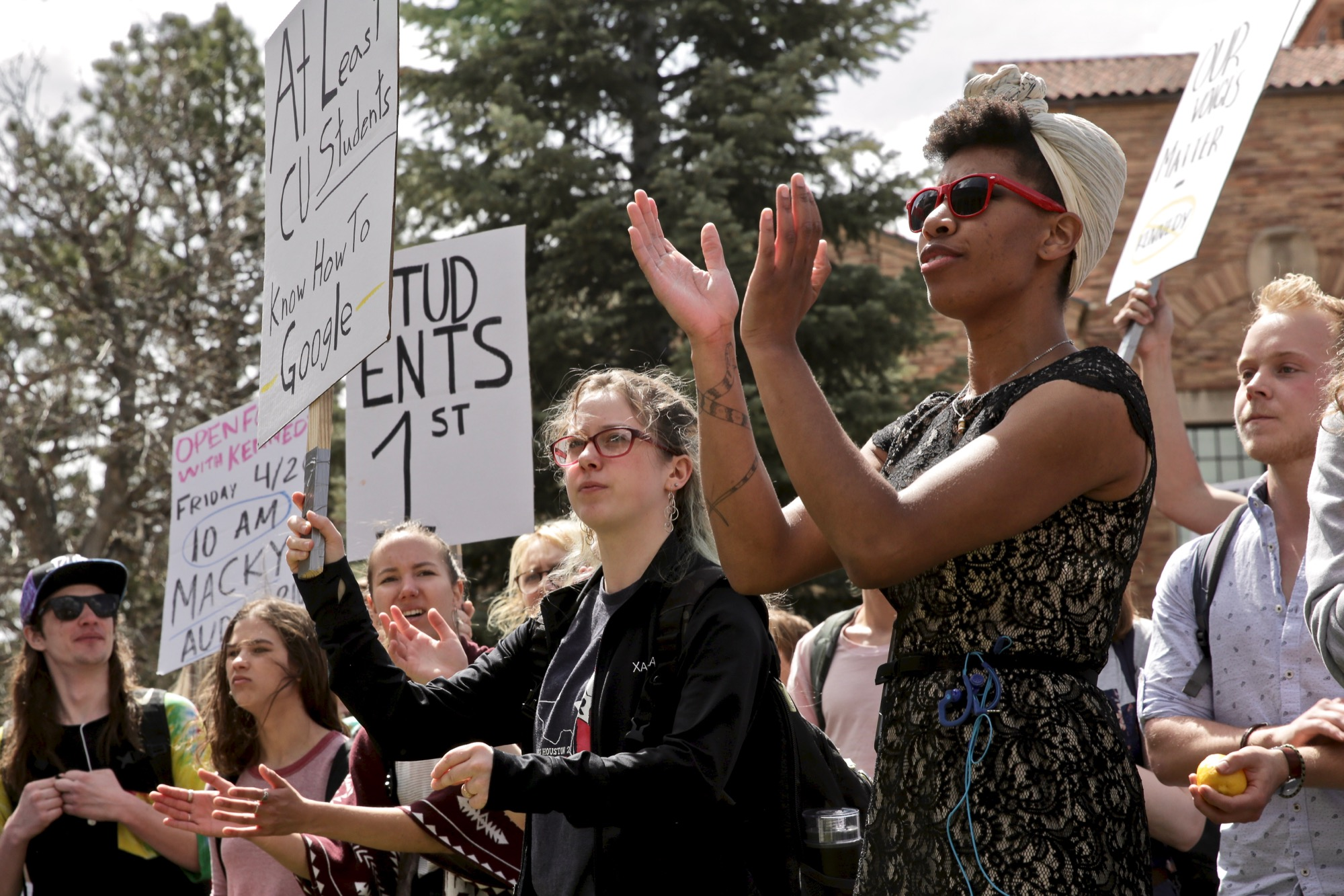 <p>Protesters opposed to the possibility of Mark Kennedy being named the next president of the University of Colorado gathered in front of Norlin Library on campus Monday April 15, 2019.</p>