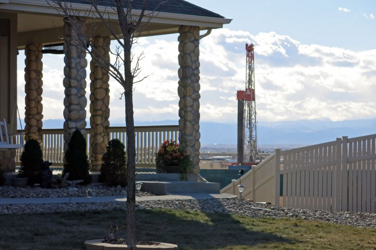 <p>A home in Weld County, with an oil drilling rig nearby.</p>