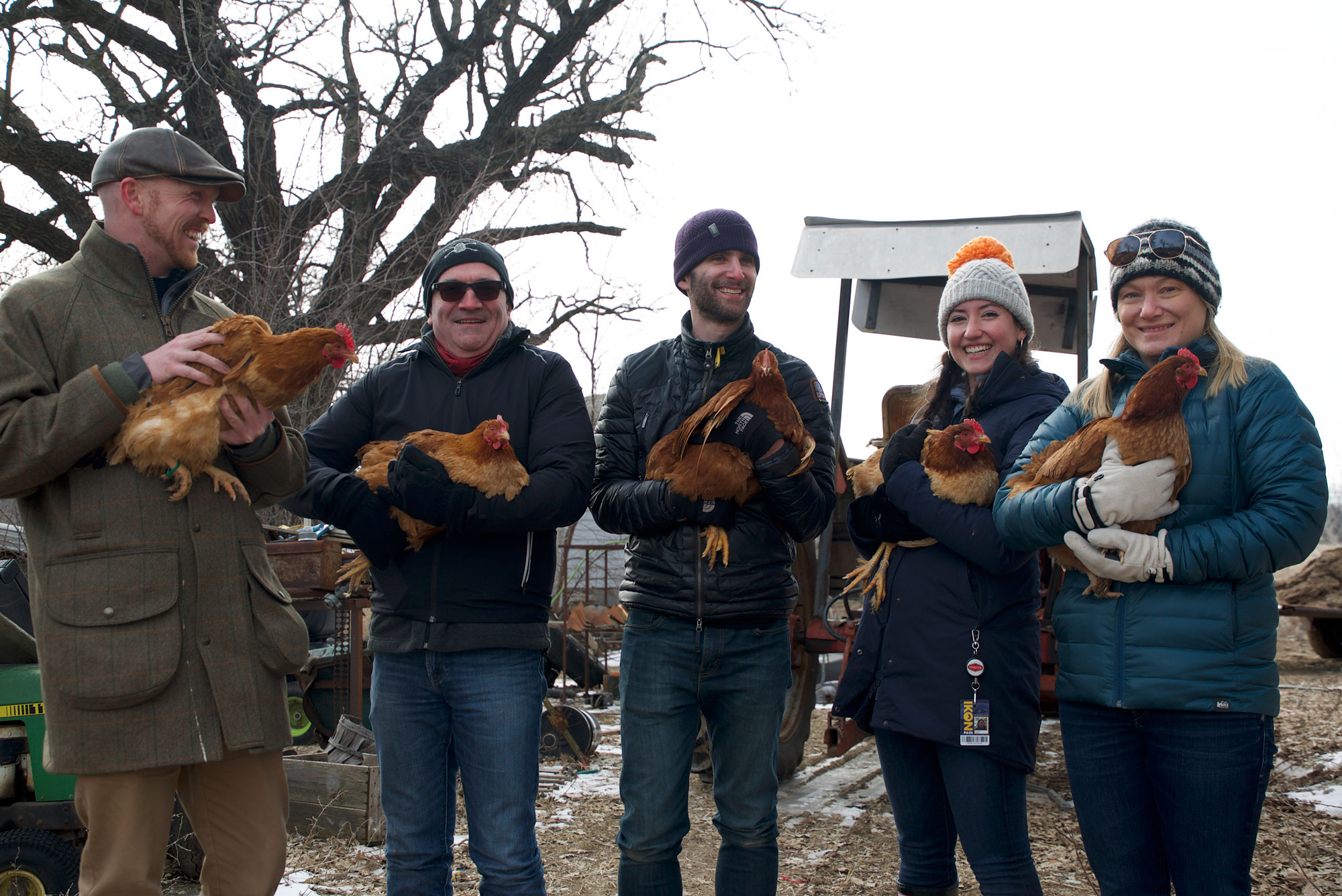 <p>Bond Pet Foods founder Rich Kelleman(center) holds the source chicken, Inga, for the line of lab-grown meat the company is testing.</p>