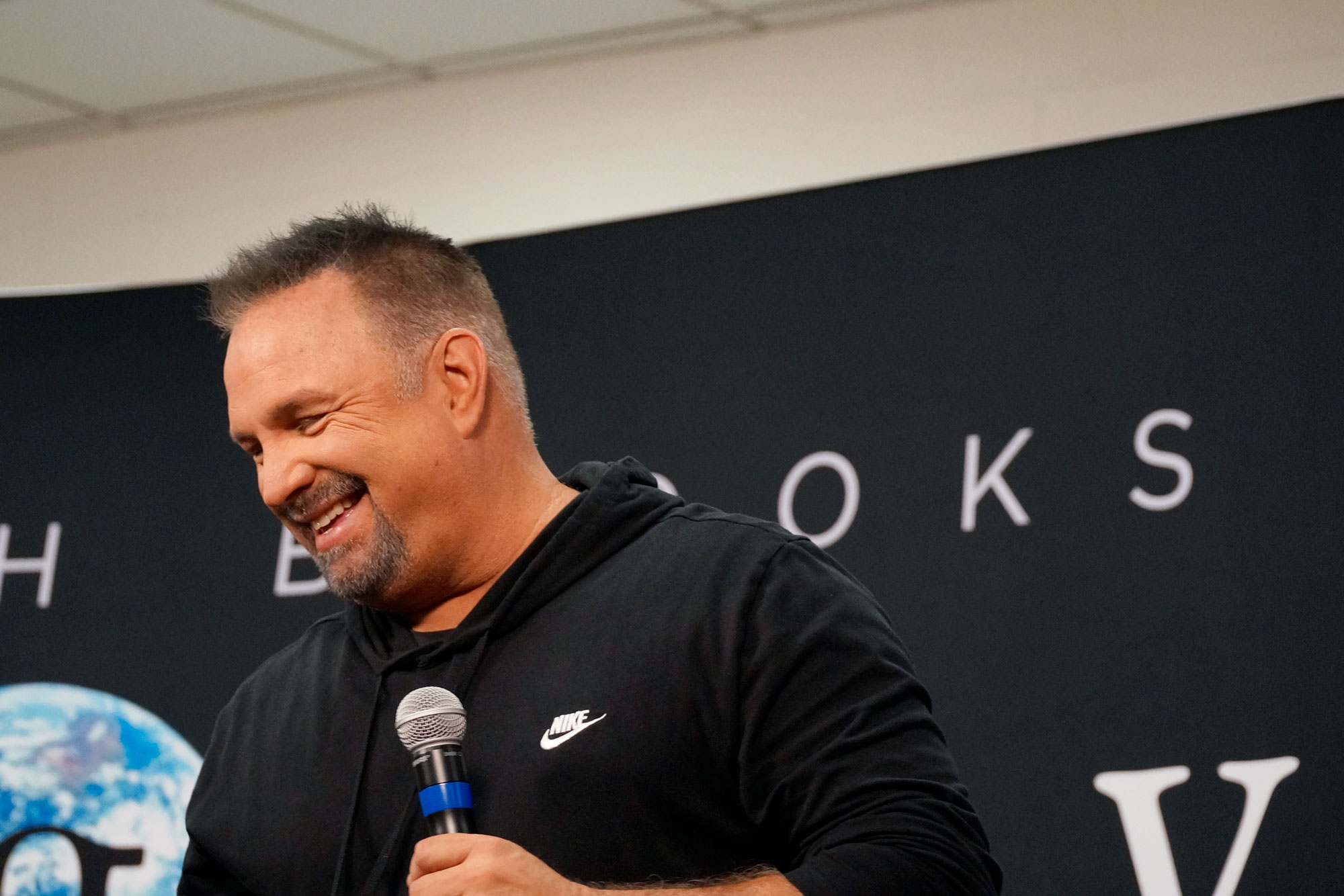 <p>Garth Brooks gives a press conference at Broncos Stadium at Mile High in Denver on June 7, 2019.</p>