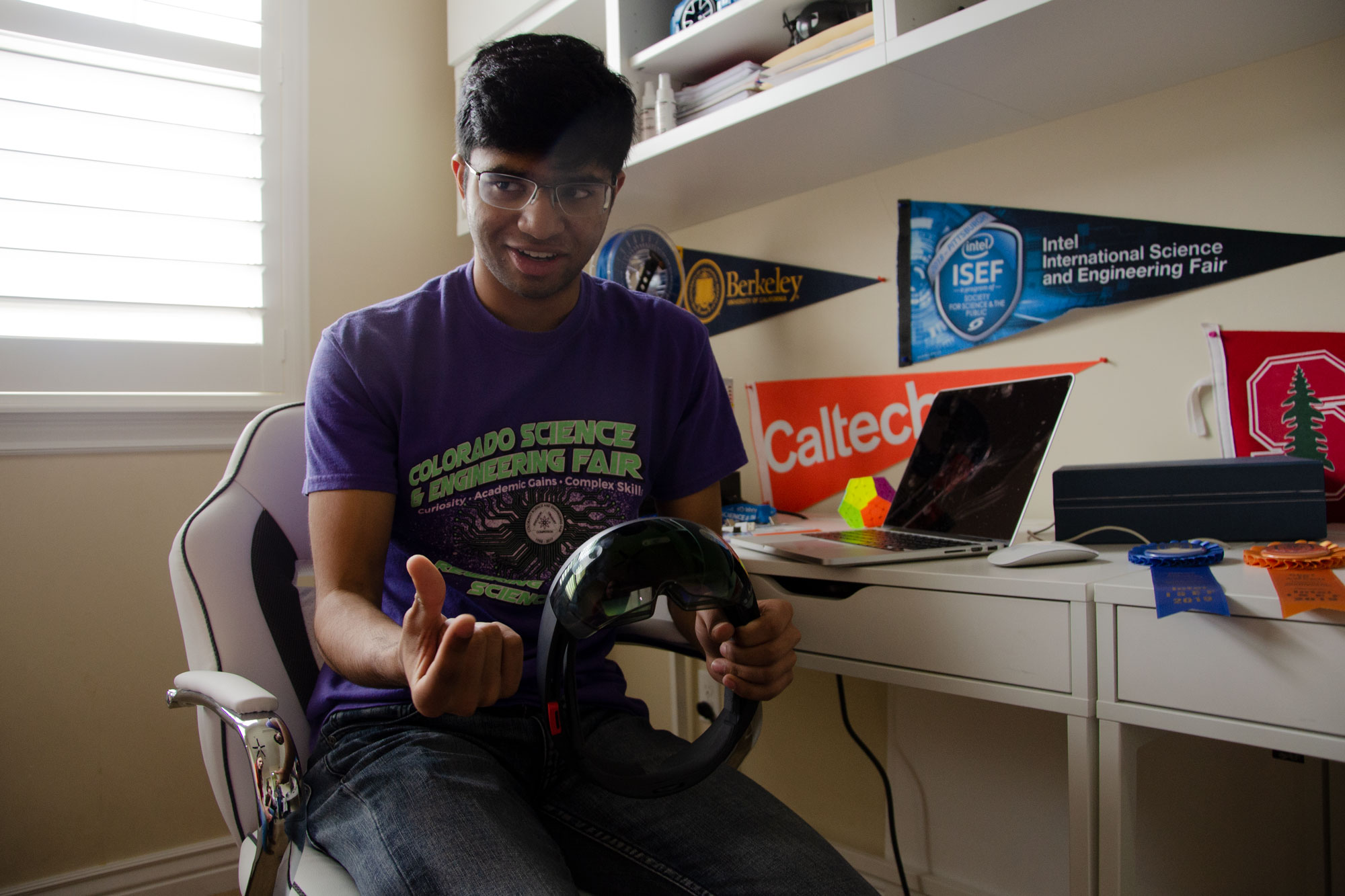 <p>Krithik Ramesh, 16, holds the augmented reality goggles he designed that won him top prize atIntel's International Science and Engineering Fair earlier this May.</p>