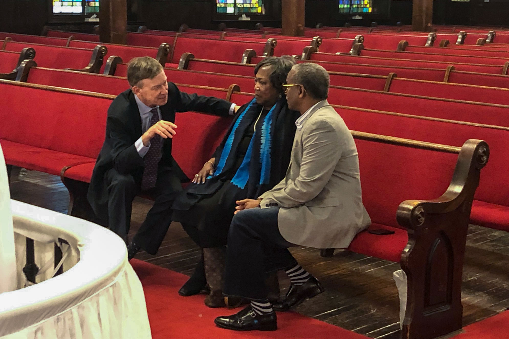 """<p style=""""color: rgb(64, 69, 64); background-color: rgb(255, 255, 255);"""">John Hickenlooper meets Polly Sheppard and the Rev. Anthony Thompson at t<span style=""""color: rgb(64, 69, 64); background-color: rgb(255, 255, 255);"""">he Emmanuel African Methodist Episcopal </span><span style=""""color: rgb(64, 69, 64); background-color: rgb(255, 255, 255);"""">Church in</span>Charleston, S.C., on Saturday, April 6, 2019.Thompson's wife was one of nine people killed by a white supremacist in a2015 shooting at the church. Sheppard was in the church during the attack but survived.</p>"""
