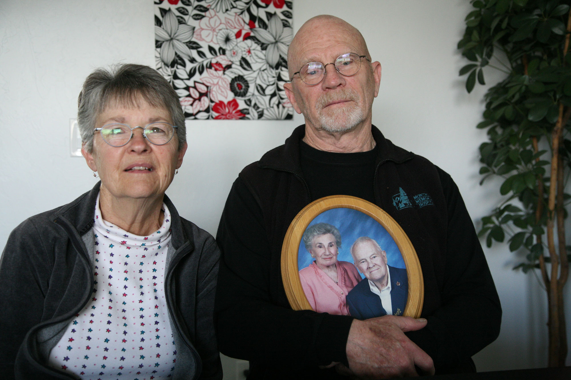<p>Barb and Ron Abbottare some of the untold number of people in the Montrose area with a loved one whose remains may have been mishandled by Sunset Mesa Funeral Directors. Ron's mother, Shirley, had made arrangements with the now-closed funeral home. Above, Ron holds a photo of his mother and his father, Bob.</p>