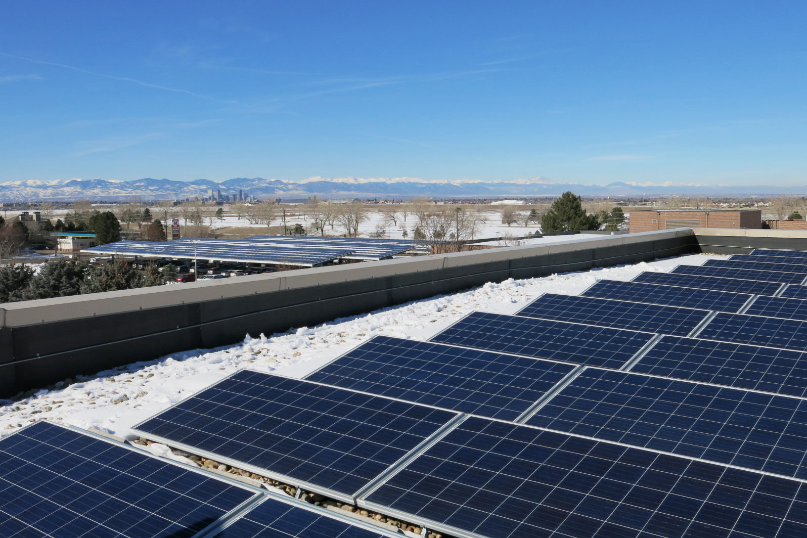 <p>Kaiser Permanente's regional Denver office hosts solar panels on its roof and carports. In an effort to reach its carbon neutral goal by 2020, Kaiser inked a deal to buy 200 megawatts of new wind and solar from sites in Arizona and California.</p>