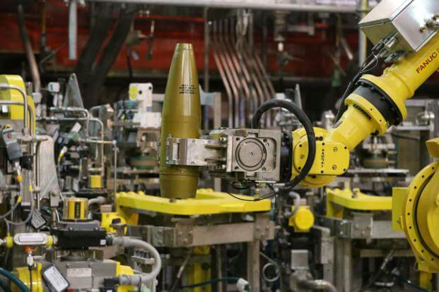 In this Jan. 29, 2015, file photo, a remotely controlled robot handles an inert simulated chemical munition during training at the Pueblo Chemical Depot in southern Colorado.