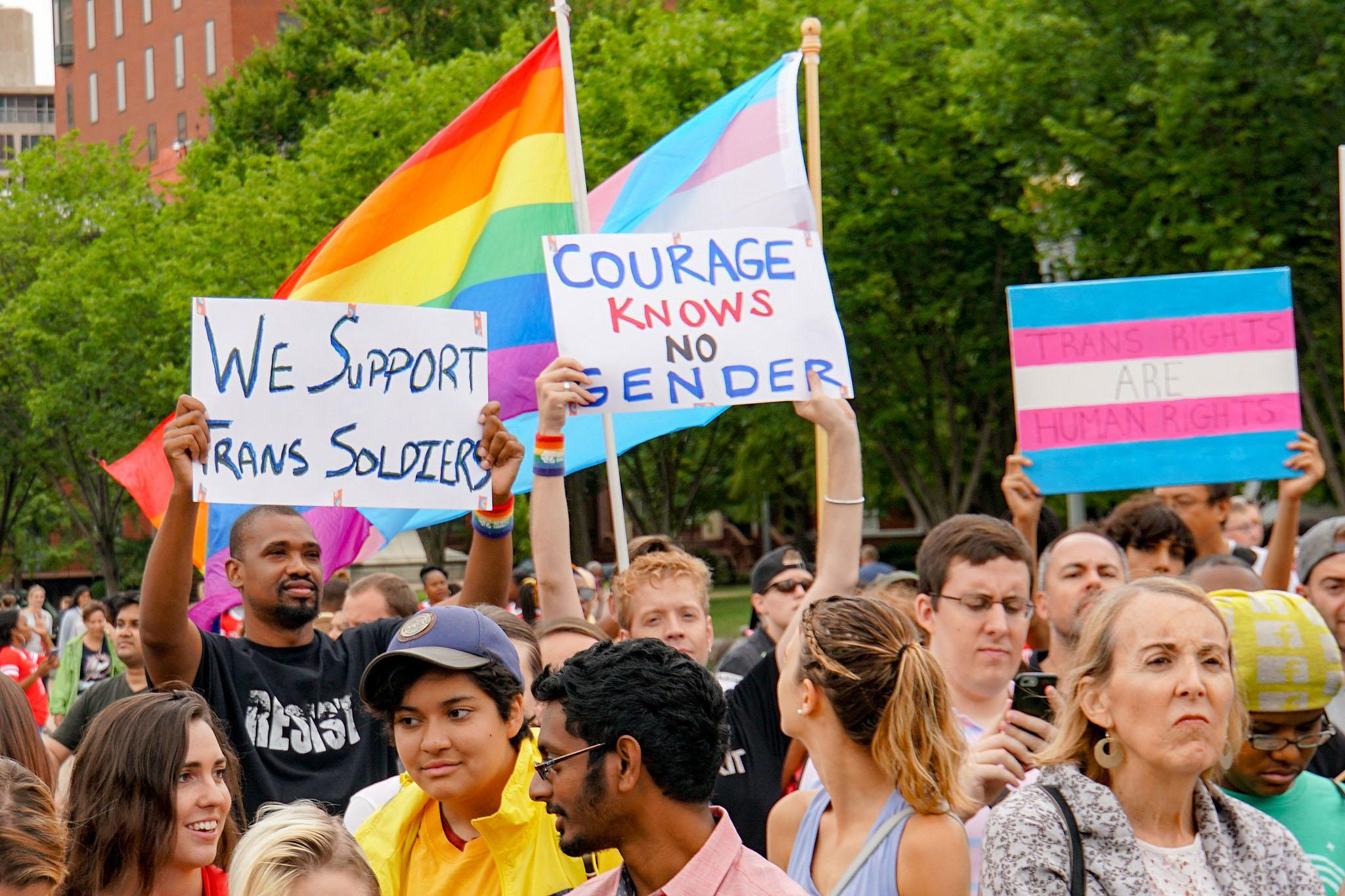 <p>Protesters opposed to the Trump Administration's military transgender ban march in Washington, D.C., July 29, 2107.</p>