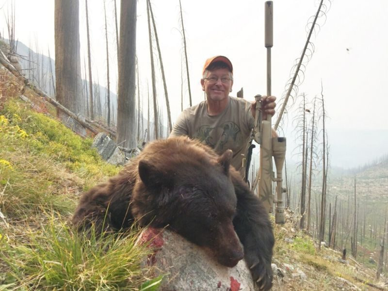 Robert Stalley, 58, of Pierre, S.D., with the bear he killed then wasted, taking only the head and hide. (Photo courtesy Colorado Parks and Wildlife)