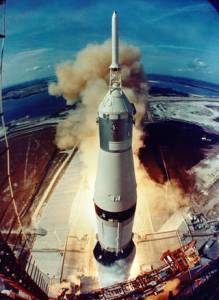 Smoke and flames signal the opening of a historic journey as the Saturn V clears the launch pad.