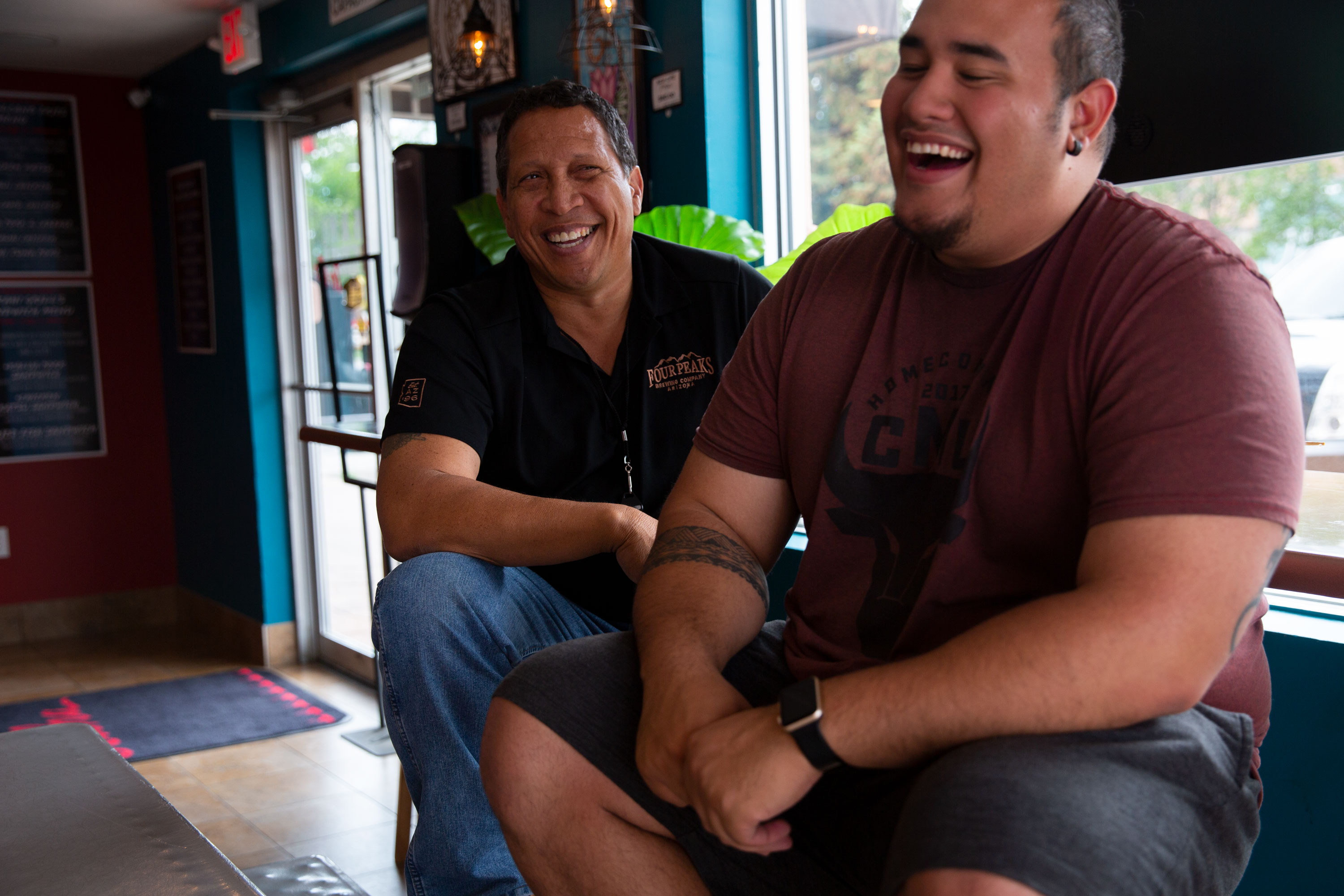 Grand Junction City Councilman Phil Pe'a (left) and Colorado Mesa University student Beau Flores laugh at Ekahi Grill on Thursday, June 20, 2019. They are just two of many native Hawaiians who now call the Western Slope home.