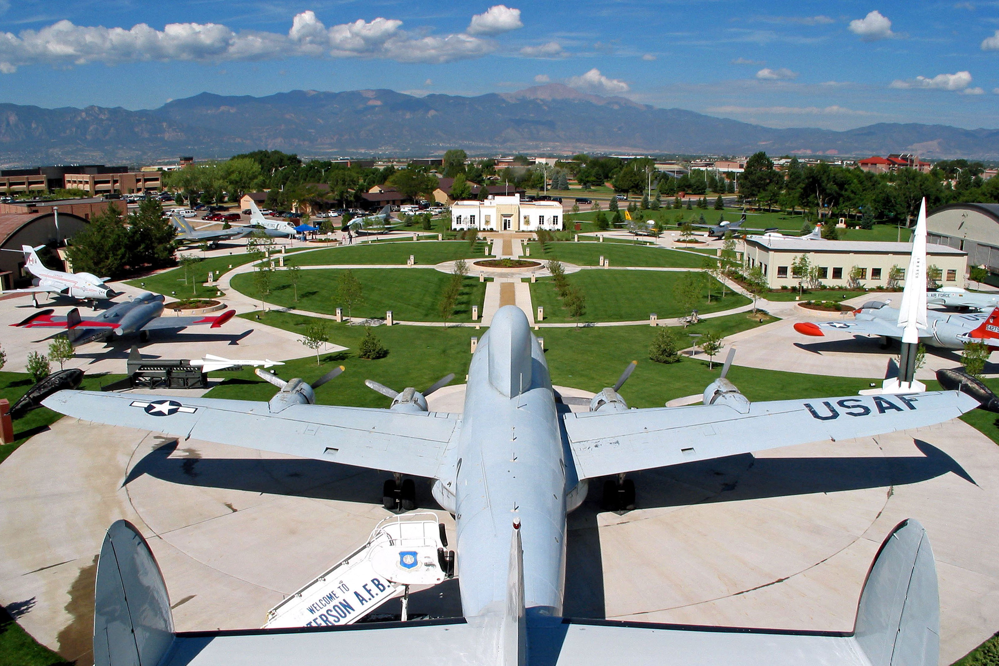 Pikes Peak looms in the background in this aerial view of the Peterson Air and Space Museum, located on the Air Force base in Colorado Springs, Colo.