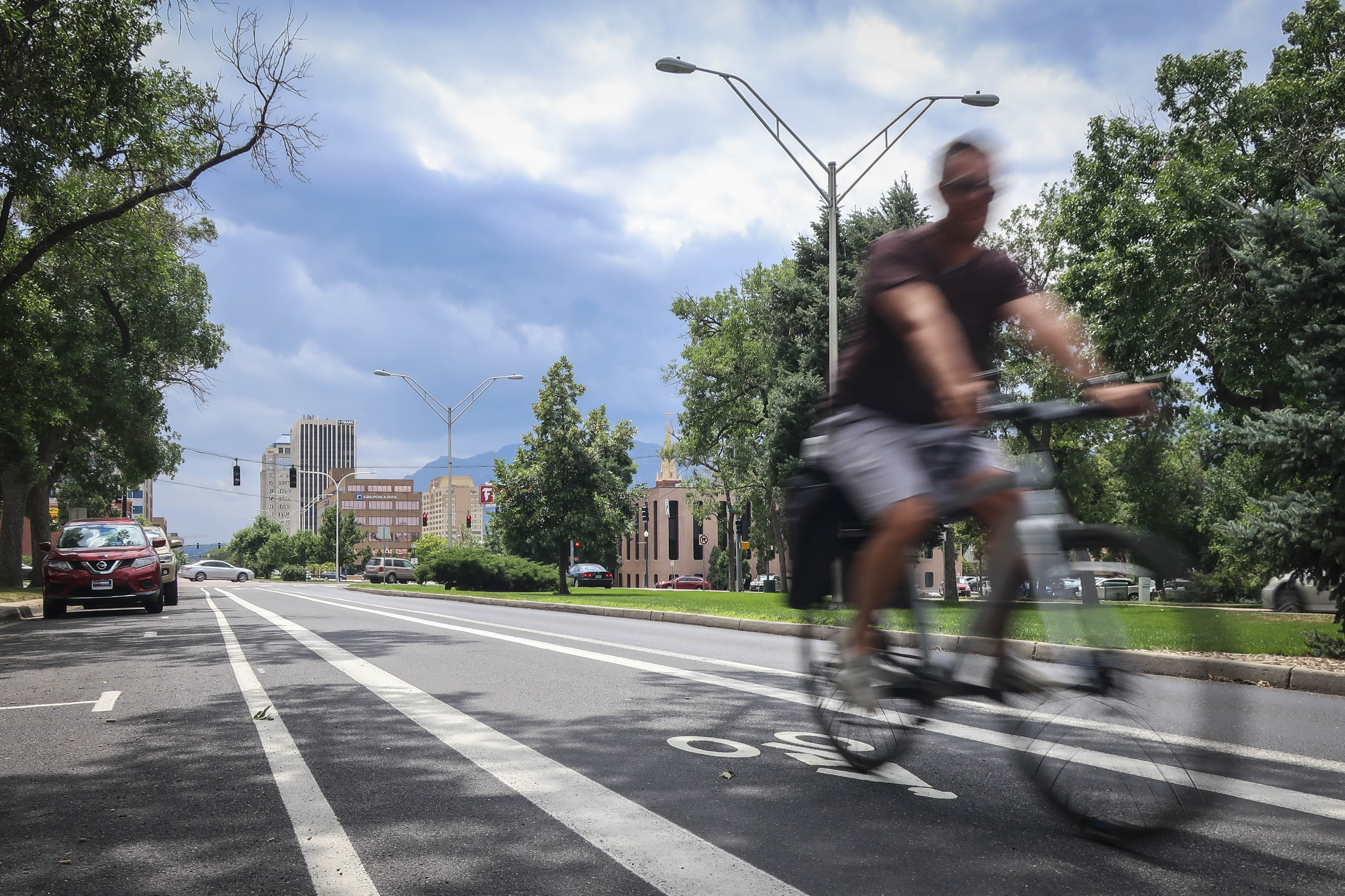 A cyclist bikes up Cascade Avenue in Colorado Springs on Thursday, August 8, 2019.