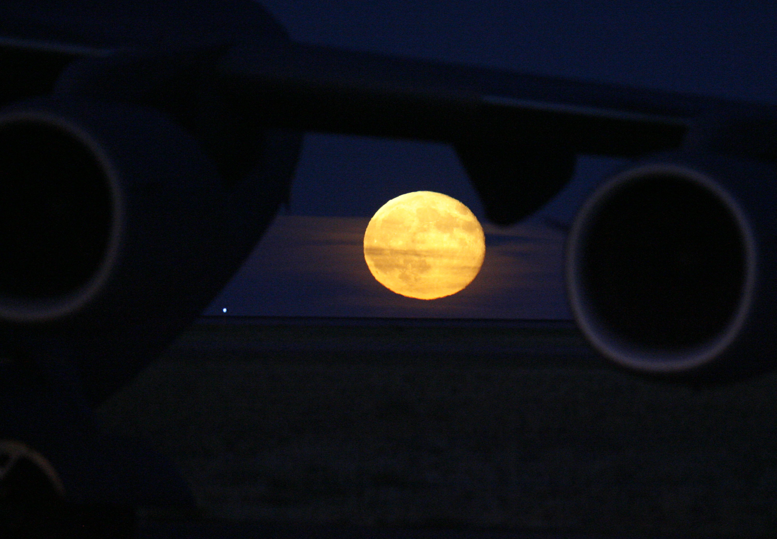 Harvest moon rises over Colorado prairie