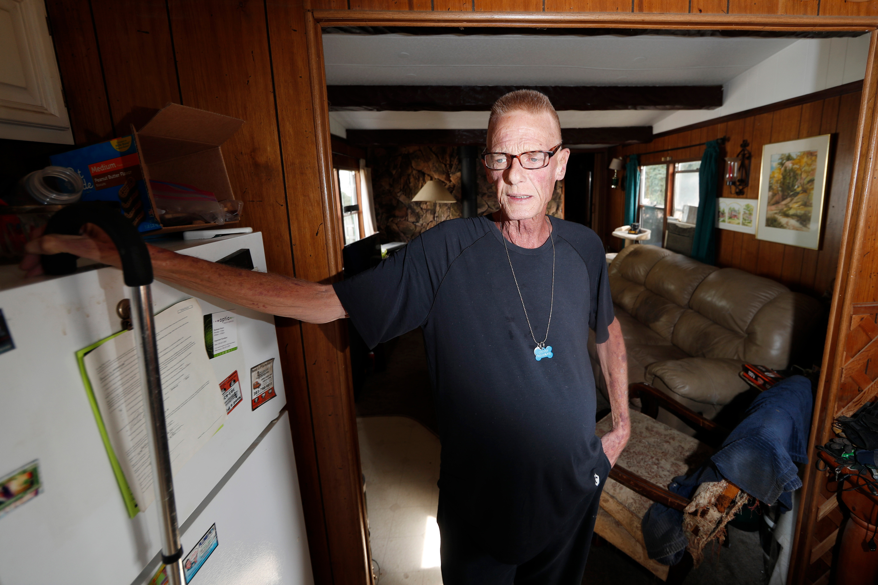 Neil Mahoney is shown inside his trailer home located in a park just below the westbound lanes of Interstate 70 Wednesday, Sept. 4, 2019, in Golden, Colo. Mahoney, who is dying of cancer, has joined forces with his doctor to say that a Colorado hospital's policy barring the doctor from administering life-ending drugs to Mahoney at his home goes against the state's assisted suicide law.
