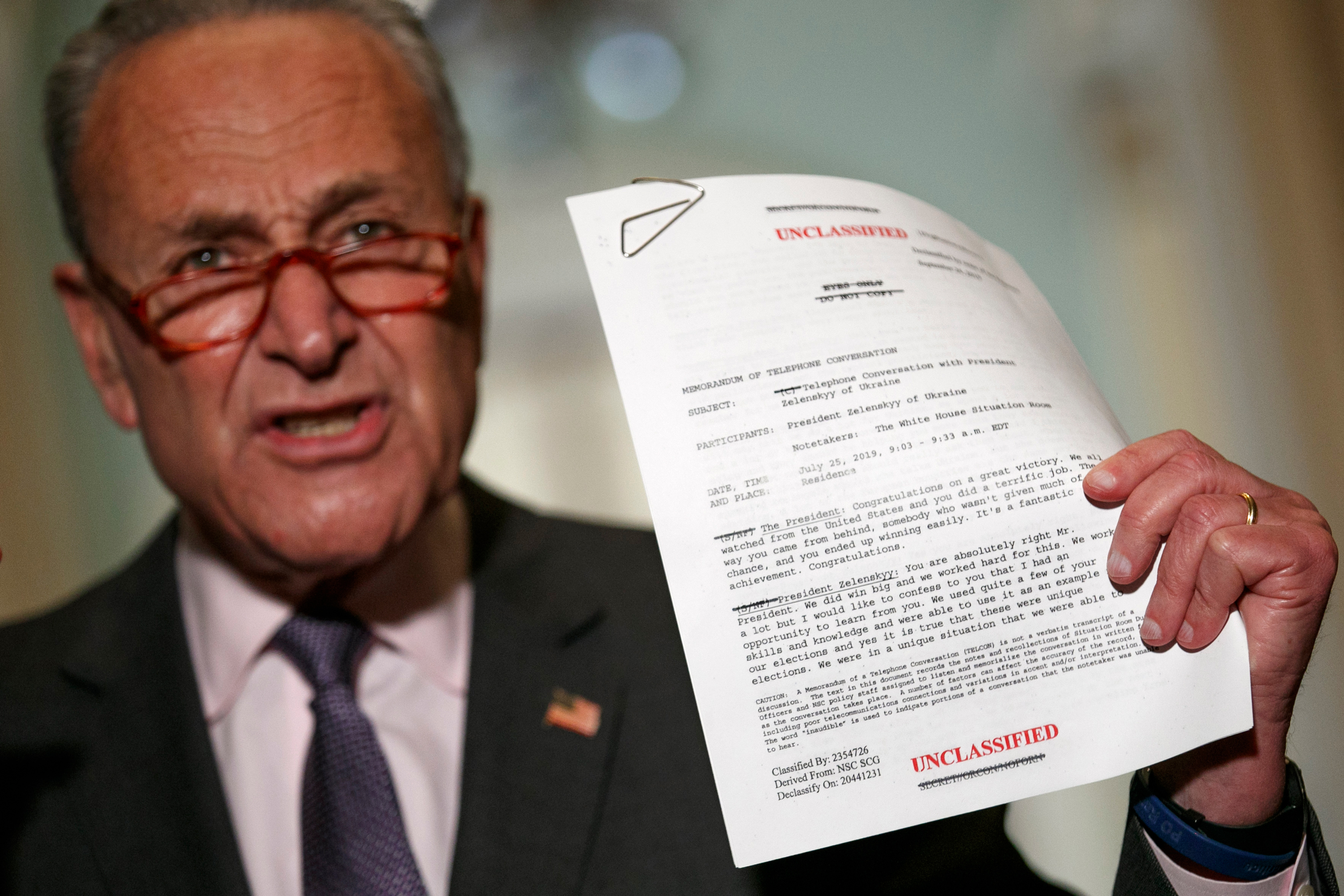Senate Minority Leader Sen. Chuck Schumer of N.Y. holds up a copy of a White House released rough transcript of a phone call between President Donald Trump and the President of Ukraine as Schumer speaks to the media about an impeachment inquiry on President Trump, Wednesday Sept. 25, 2019, on Capitol Hill in Washington.
