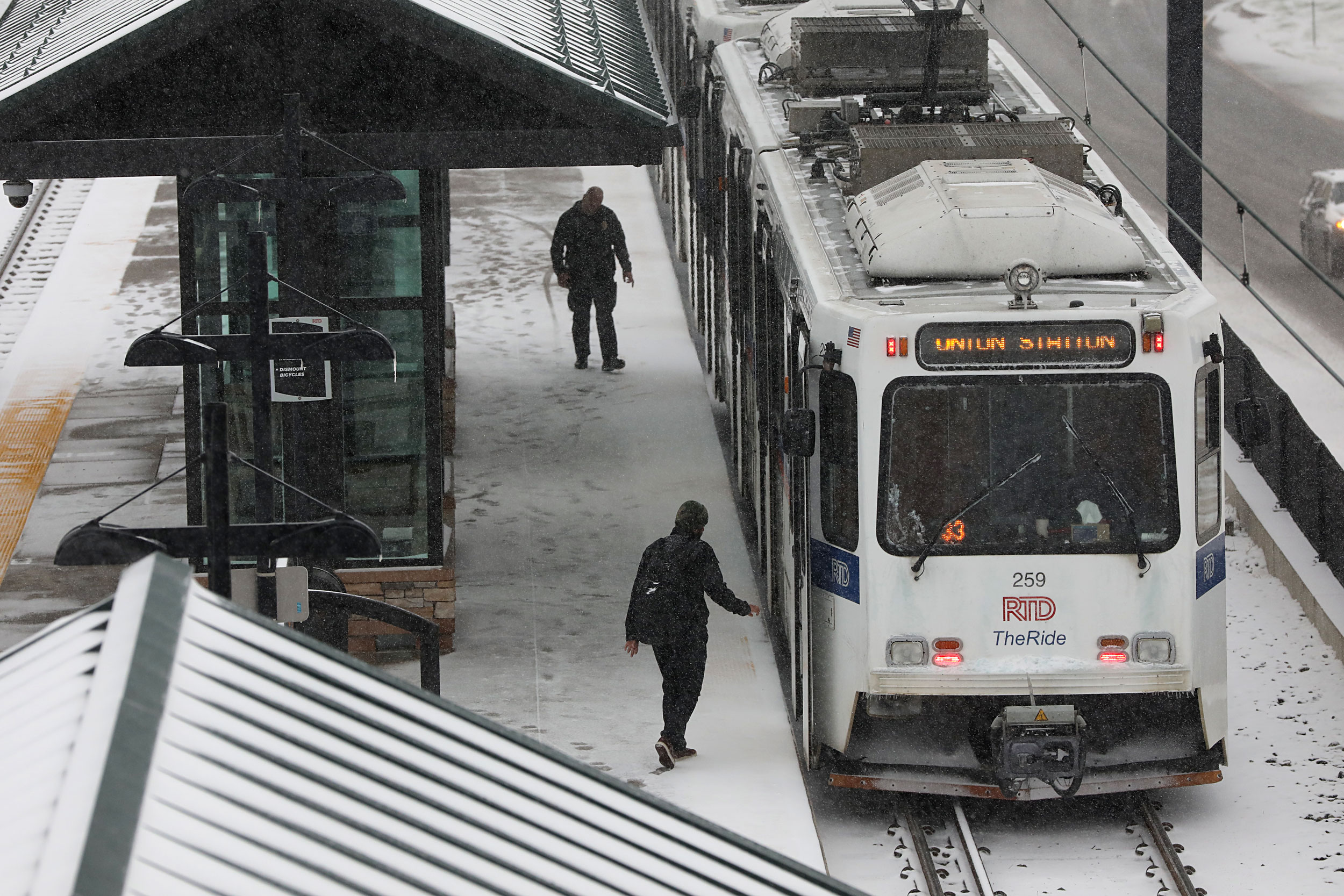 The Denver metro commute was slow Thursday morning Oct. 10 as the season's first snow fell on the north and central Rockies and the Front Range. An RTD light rail train stopped at the Dry Creek Station.