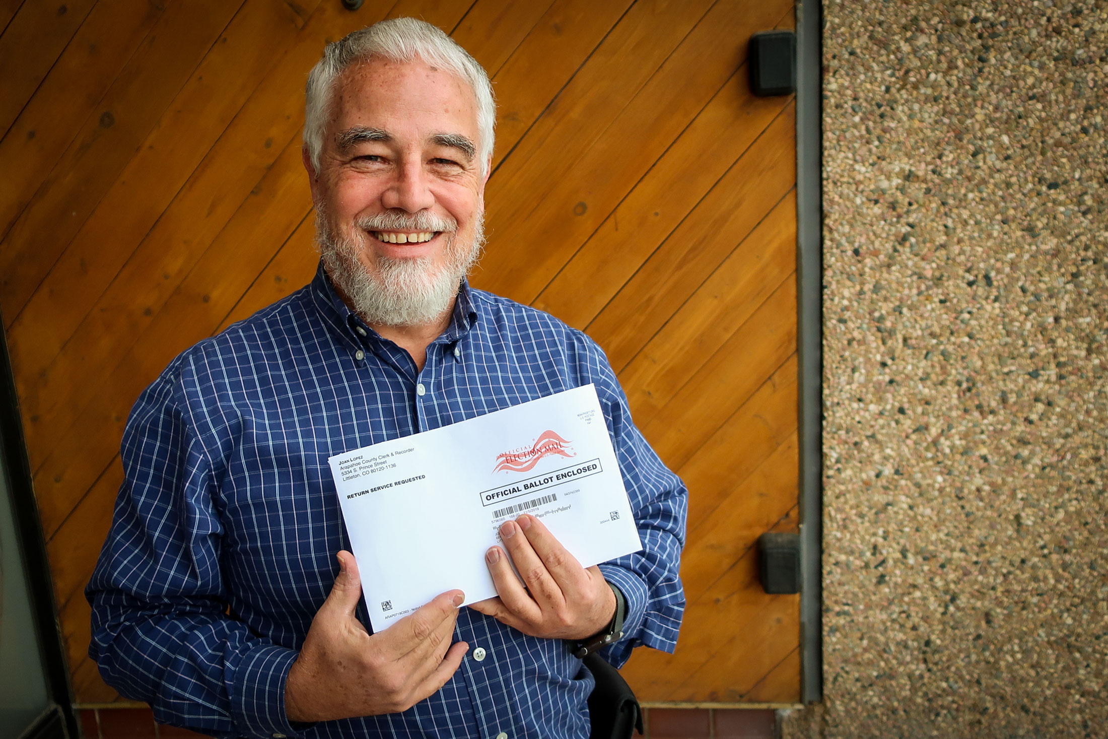John Waber of Littleton, and his ballot, stopped by the Colorado Public Radio studios to find out why some questions were printed in ALL CAPS, Oct. 17, 2019.