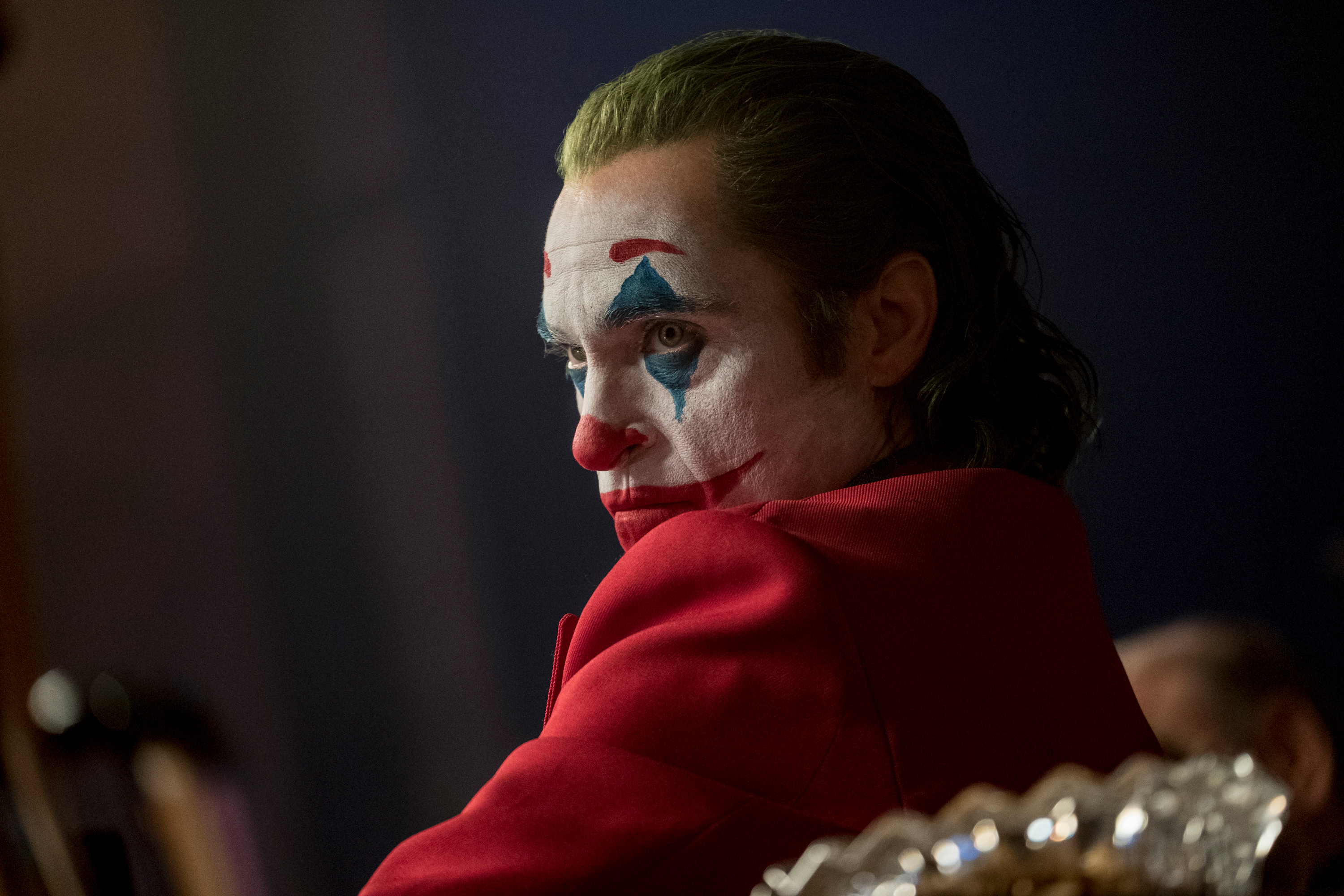 """This image released by Warner Bros. Pictures shows Joaquin Phoenix in a scene from """"Joker,"""" in theaters on Oct. 4. Alarmed by violence depicted in a trailer for the upcoming movie """"Joker,"""" some relatives of victims of the 2012 Aurora movie theater shooting asked distributor Warner Bros. on Tuesday to commit to gun control causes. Twelve people were killed in the suburban Denver theater during a midnight showing of the Batman film, """"The Dark Knight Rises,"""" also distributed by Warner Bros."""