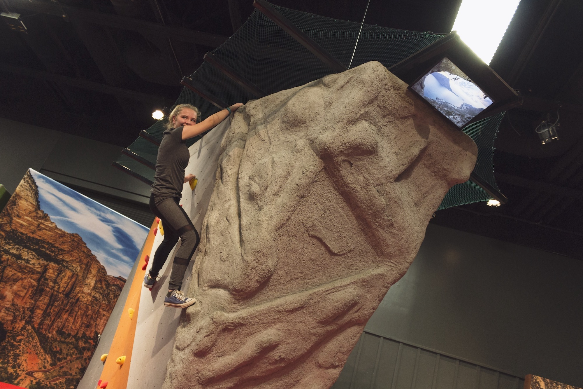 """A visitor tries out one of the interactive activities at the Denver Museum of Nature and Science's """"Extreme Sports"""" exhibition."""
