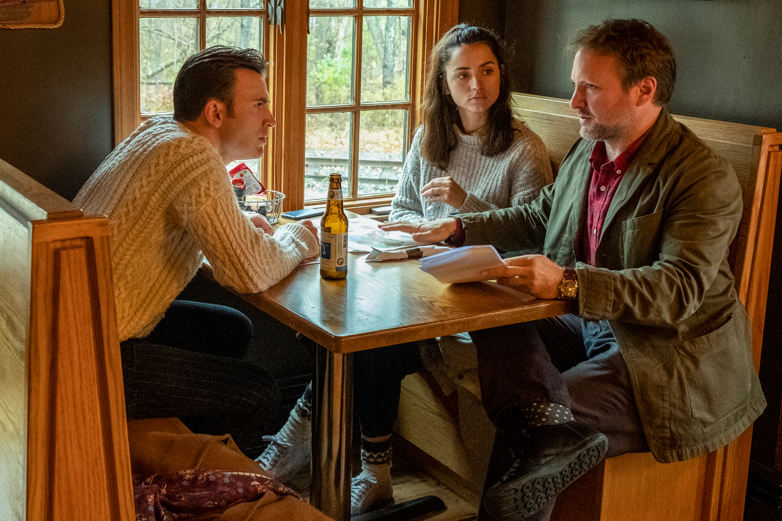 """Chris Evans (left), Ana de Armas (center) and director Rian Johnson on the set of """"Knives Out."""""""