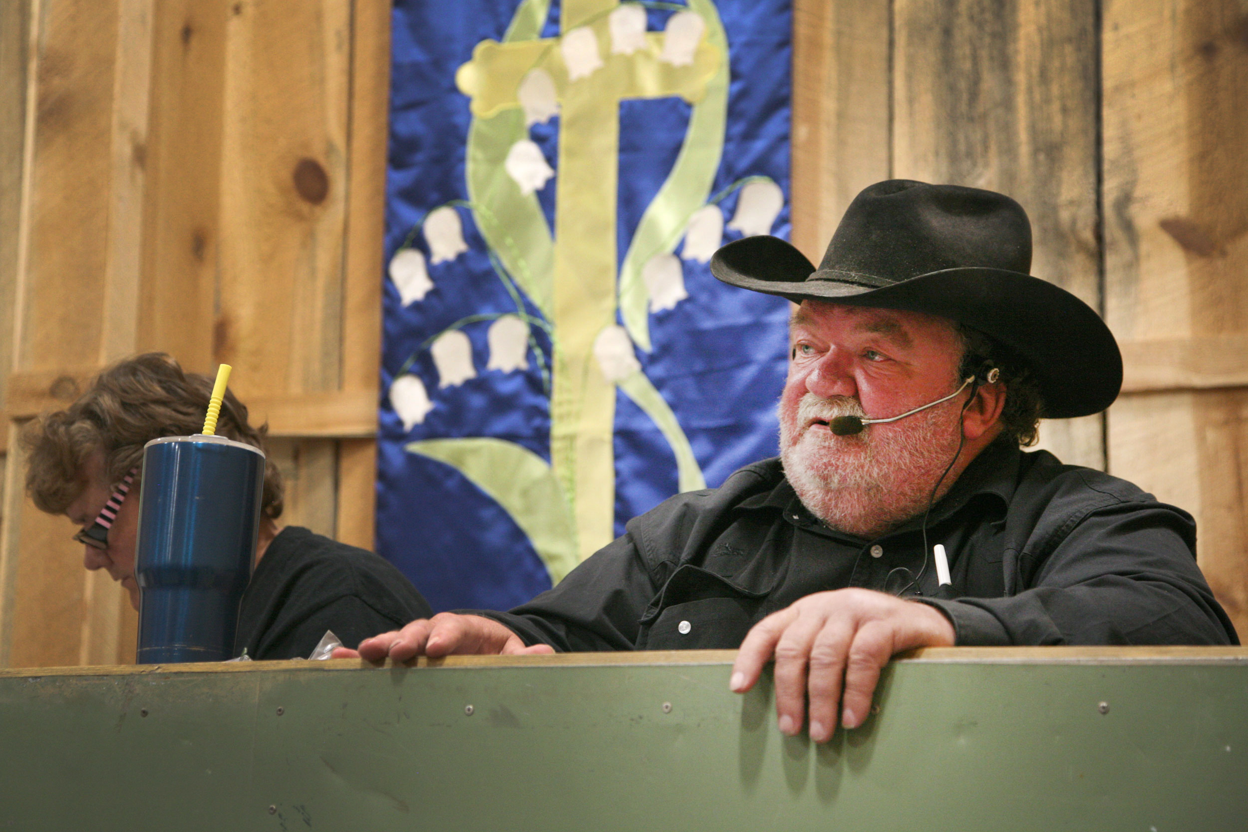 Glenn Miles leads an auction recently at Backcountry Good Trading in Hotchkiss, selling off everything from rifles and saddles to Christmas ornaments and decorative sweaters.