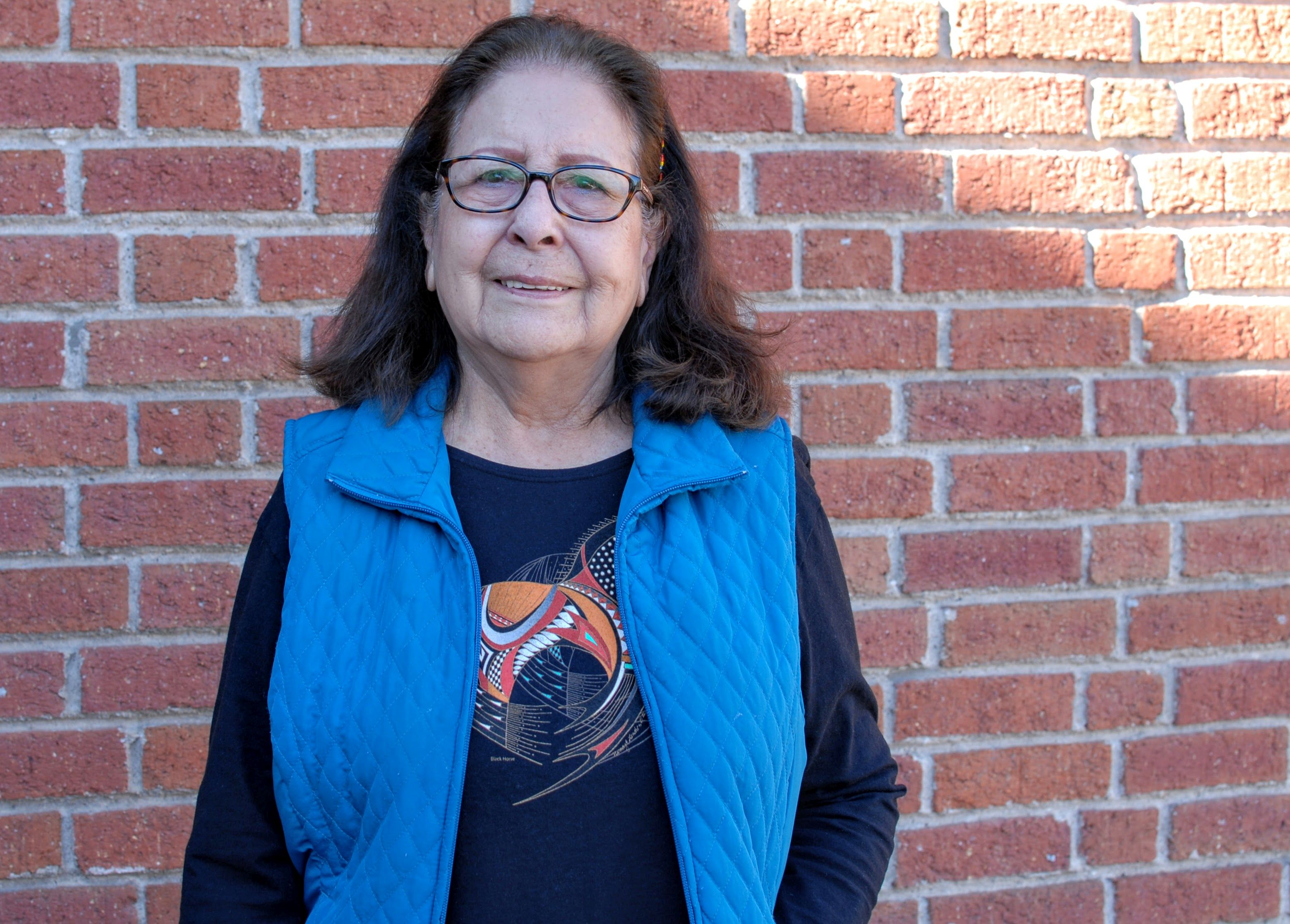 Doris Goodteacher outside a library in Denver on Nov. 14, 2019. Goodteacher's family relocated from a reservation to Denver in the 1950s as part of a  Bureau of Indian Affairs program.