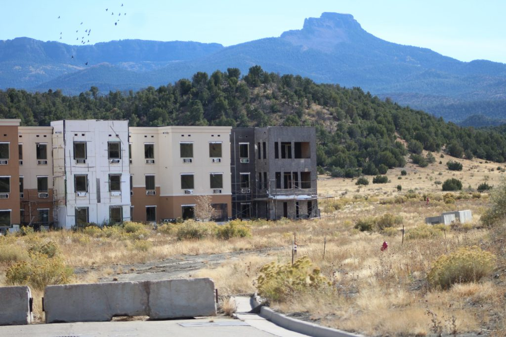 Fisher's Peak rises behind the unfinished hotel and spa at Cougar Canyon.