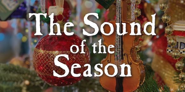 """Close up of Christmas tree ornaments with the words """"The Sound of the Season"""""""